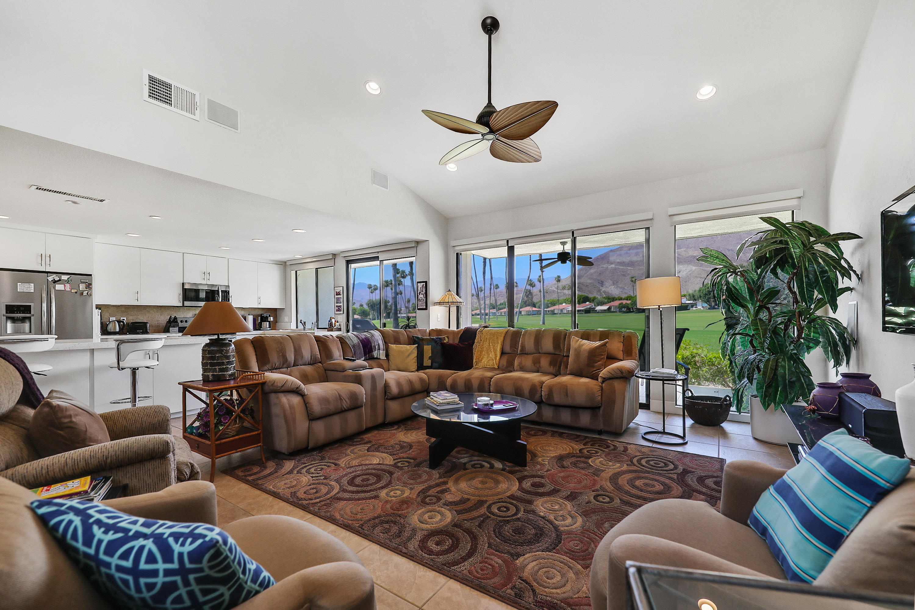 The term ''LOCATION'' is often exaggerated, however in the instance it is actually understated! This magnificent condo in the Rancho Las Palmas Country Club is within easy walking distance of ''The River'' shopping center, the OMNI Hotel and the clubhouse. Located on the 7th hole of the west course it has an extra wide fairway view plus you can actually see people walking on the ''Bump-and-grind'' trail in the southern mountain view. Completely professionally remodeled to have that open concept with all amenities. This spectacular 2 bedroom, 2 bathroom condo would make a wonderful vacation getaway or even a full time residence. It is being sold turn key furnished and includes quartz counters, stainless steel appliances in the kitchen and totally remodeled bathrooms with tile showers.