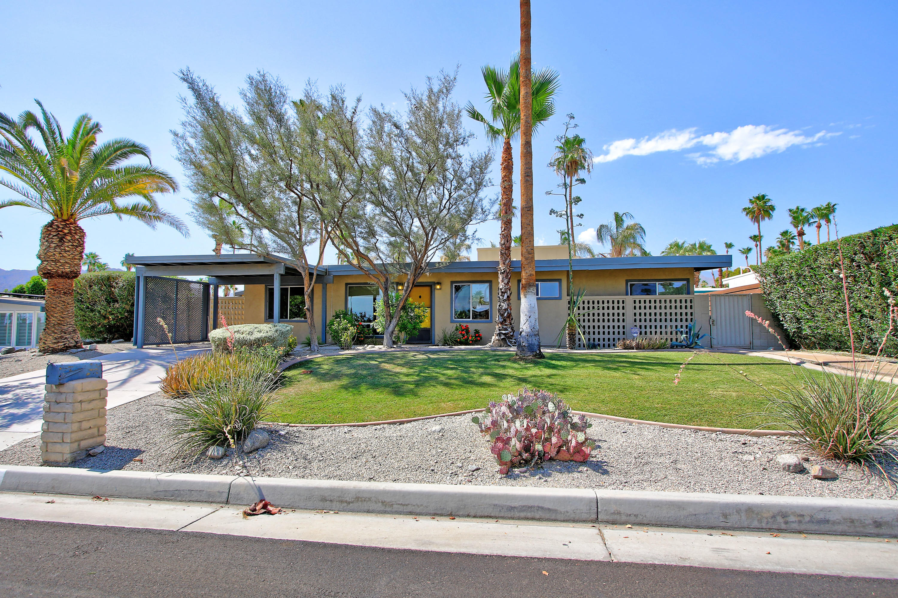 Wait until you see this incredible MID CENTURY POOL HOME IN SOUTH PALM DESERT!! It doesn't get better than this! This great home has been upgraded to the MAX! and offers a spacious GREAT ROOM, 2 bedrooms, DEN, 2 baths and a VERY PRIVATE back yard with Sparkling Lap Pool with Sheer Descent Waterfall! Talk about WOW!!  Check out the Open Gourmet Kitchen with Slab Granite Counters and Full Backsplash!  Stainless Steel Appliances including a WOLFF OVEN, Vaulted Beam Ceilings, Free standing Fireplace are some of the custom features of this fabulous home! 2 NEW A/C Units with 10 year Warranties  and 2 New Thermostats WIFI enabled! The Primary bedroom is spacious and has an ensuite bath with dual basins and Custom Stone Frameless Shower! The hall bath has a Jetted Tub and designer sink! 2 new toilets in both bathrooms! Ceiling Fans throughout! Great storage on side of the home. Owner has thought of everything!!! Beautiful tranquil neighborhood  close to El Paseo, world class dining and shopping, hiking trails and The Living Desert! HOA's only $$180 per year!! This is an A+++ PRIME PROPERTY AND SHOULD BE AT THE TOP OF YOUR MUST SEE LIST TODAY!!!