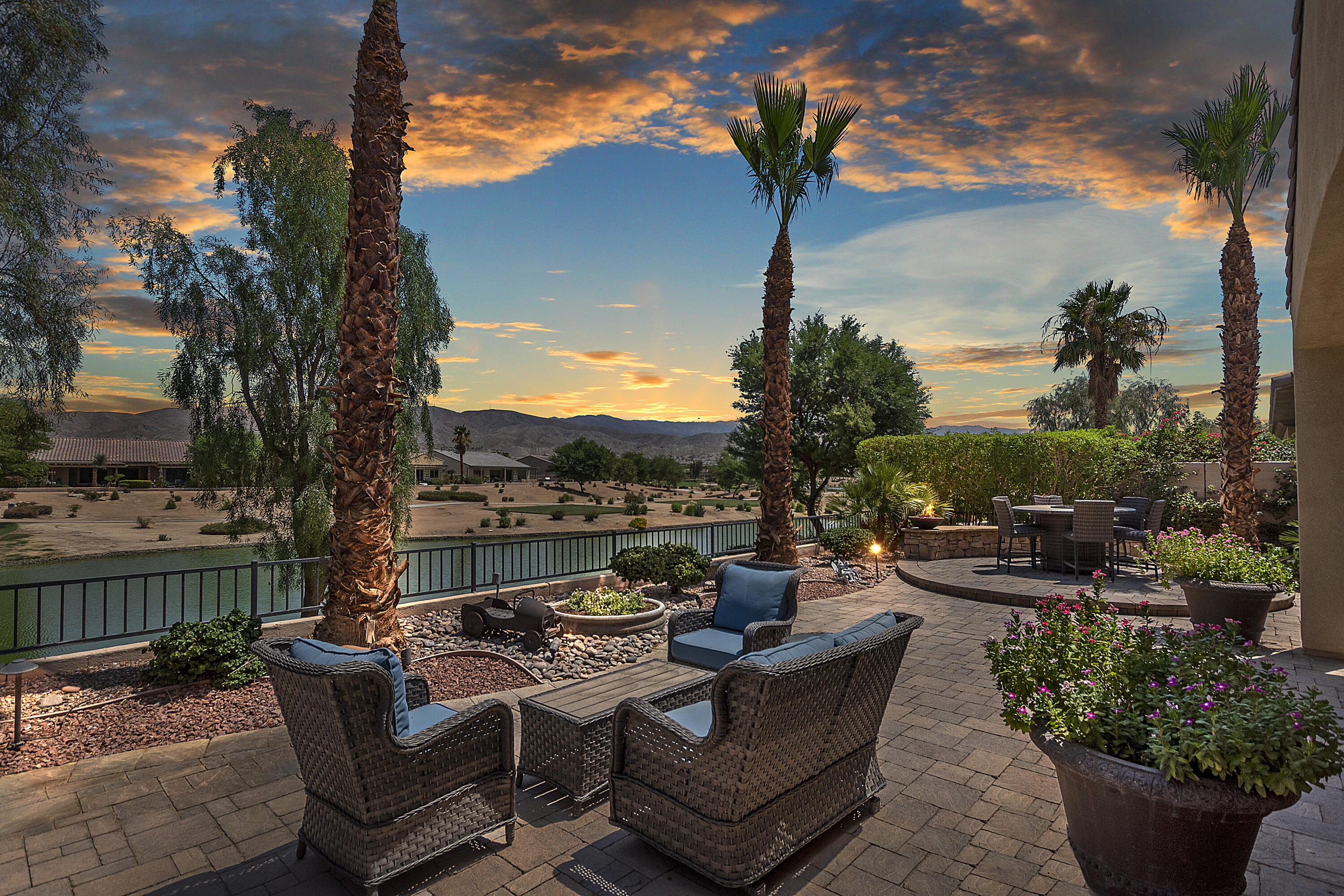 Yeah, yeah, yeah we agents always say, 'This is THE ONE you've been waiting for' and repetition, IT'S TRUE! This is an exceptional property. The trifecta, Golf Course, Lake, and Mountain Views! Love the Life, Live the Dream is my motto. An Avelino model has an open floor plan, 2BR/2BA plus a den. This one has many upgrades. I esp. LOVE the brick cobblestone patios in both the front & back yards ~ relaxing sound of trickling fountains ~ and ample seating choices, both covered and unshaded depending upon your mood and the time of day. The beveled glass inlay front door filters light in beautiful patterns. 'Cheery', 'immaculate', 'worthy' are all fitting adjectives. ('Worthy' is for you!) Quality workmanship on the wall-to-wall great room book/display shelving adds storage, interest, and an overall coziness to the room. Some furnishings available to get you started in your new home... ABSOLUTELY will not last. Take a break from your BBQ and come see for yourself. SCSH is the best value for country club amenities. Every imaginable interests - over 100 jam-packed clubs with activities galore. And golf/tennis/pickle ball... are all excellent ways to meet instant friends with shared interests. You will feel right at home in no time and wonder why you didn't do this sooner. Promise!