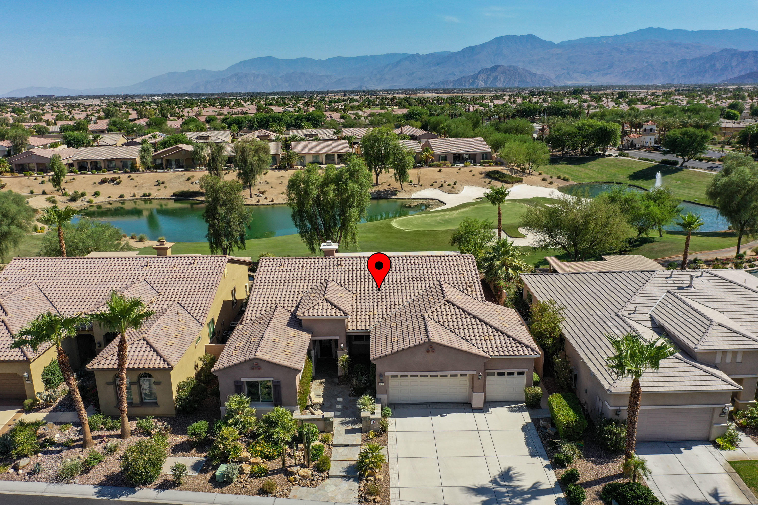 This wonderful South facing waterfront property features an extraordinary Dorado floor plan built high above a lake and a golf course green! It is like stadium seating as below you golfers putt out on the 6th hole of the renowned Executive Par 3 Course. The patio has been transformed into a desert out-door living room with a flagstone deck, extended Alumawood cover above, a large BBQ Island & a fire-pit. Sunsets and lingering twilight skies are spectacular. The impressive entry courtyard has a flagstone finished deck and a cut-glass front door.  Inside there is tile flooring laid on the diagonal, designer paint on walls, plantation shutters & custom covers on windows and fans on soaring ceilings. The kitchen has beautiful granite countertops, quality dark cabinets that frame stainless steel appliances to create a stunning look. The open great room has a cozy gas fireplace for those cool winter evenings. The master suite has patio access, dual vanities, an oval tub, a separate glass enclosed shower and a generous walk-in closet. The 3 car garage has a finished floor, an A/C unit, a water softener, windows & a tankless-instant hot water unit. Much more.  Everything like new and meticulously finished to please the most discriminating buyer who expects quality and loves perfection!