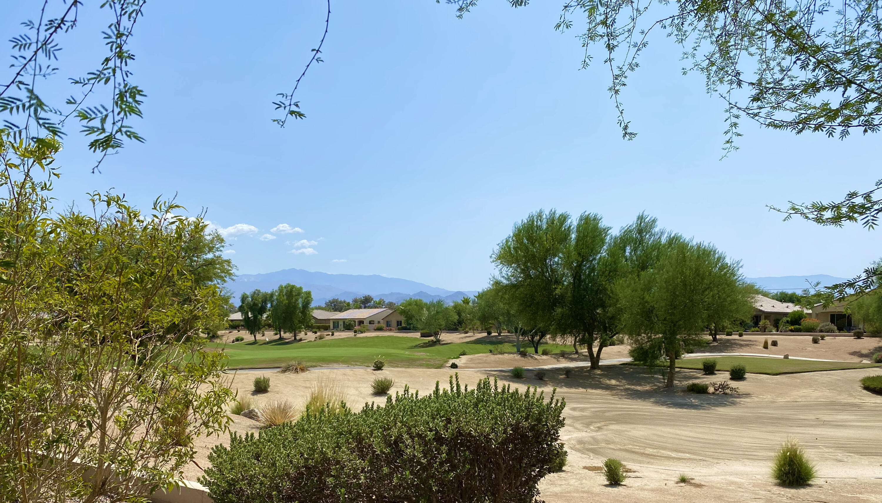 Located on the North course in Phase 3 of Sun City Shadow Hills, a 55+ community, is this popular Avalino floor plan featuring stunning golf course and mountain views, 2 bedrooms, 2 baths and a den/office.  High ceilings and open floor plan.  Beautiful wood look ceramic tile in the Great Room.  Chef's kitchen with center island with bar seating. Lots of counter area and pantry.  Dining area faces golf course.  Custom window coverings throughout.  Custom paint.  Covered and extended patio area in back yard to enjoy the views and entertain family and friends. The Master suite features dual vanities, separate soaking tub and shower and custom walk-in closet.  Den/office is a nice retreat area.  Separate laundry room with cabinets and sink.  Front door screen.  Garage features epoxy coated floor, built-in storage, and evaporative cooler.  Beautifully furnished and decorated.  Furnishings included outside of escrow, per inventory, at no value. High speed Internet included in monthly HOA fee.