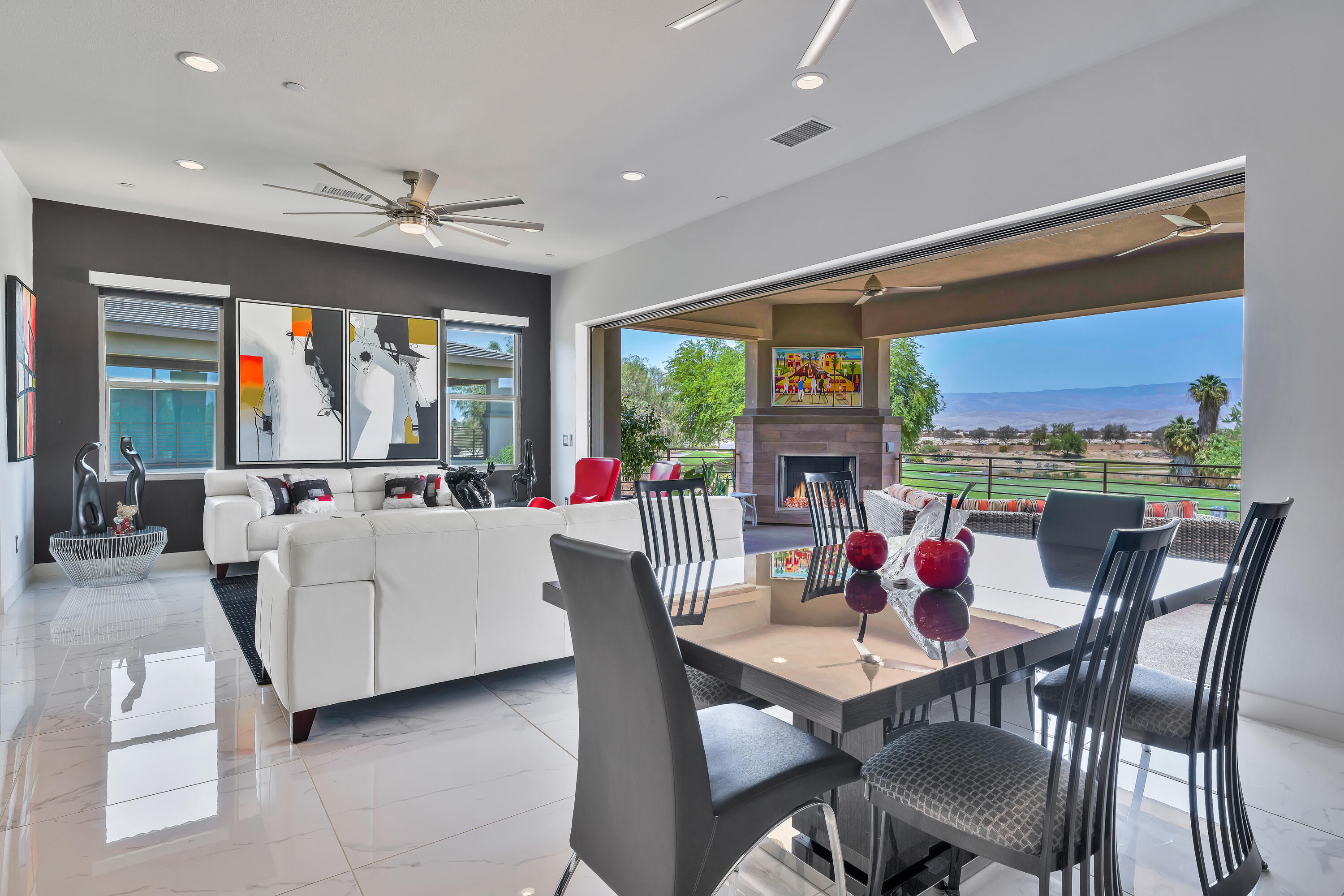 Perhaps the Best property to ever hit the market in the highly desired gated community The Retreat at Desert Willow. This stunning Desert Contemporary home has been highly upgraded including polished tile floors, LED lighting, remote control window coverings with solar shades and Quartz bathroom countertops. The designer kitchen features stylish white cabinetry, Quartz countertops & backsplash, oversized island with a double waterfall edge, Stainless-Steel appliances and opens to the dining area. The Great Room has pocket sliding doors opening to the oversized 28 ft covered patio with fireplace and privacy shade creating the ultimate indoor / outdoor living space. This upper unit offers 3 spacious bedrooms, 3 bathrooms, a sitting area, tech area and 2-car attached garage complete with air conditioning. The best part of all is the home has an elevator so you can avoid the stairs if so desired. With the turnkey convenience and low maintenance of a condo community The Retreat amenities are five-star resort quality with a large pool & spa, a lap swimming pool, gym, community room with pool and ping pong tables and beautifully landscaped grounds all around. Plus, private golf cart access to the impeccable Desert Willow Resort including discounts and access privileges offered at no other community. Offered fully furnished and impeccably maintained, once you move-in every day in this home will feel like you're on vacation.