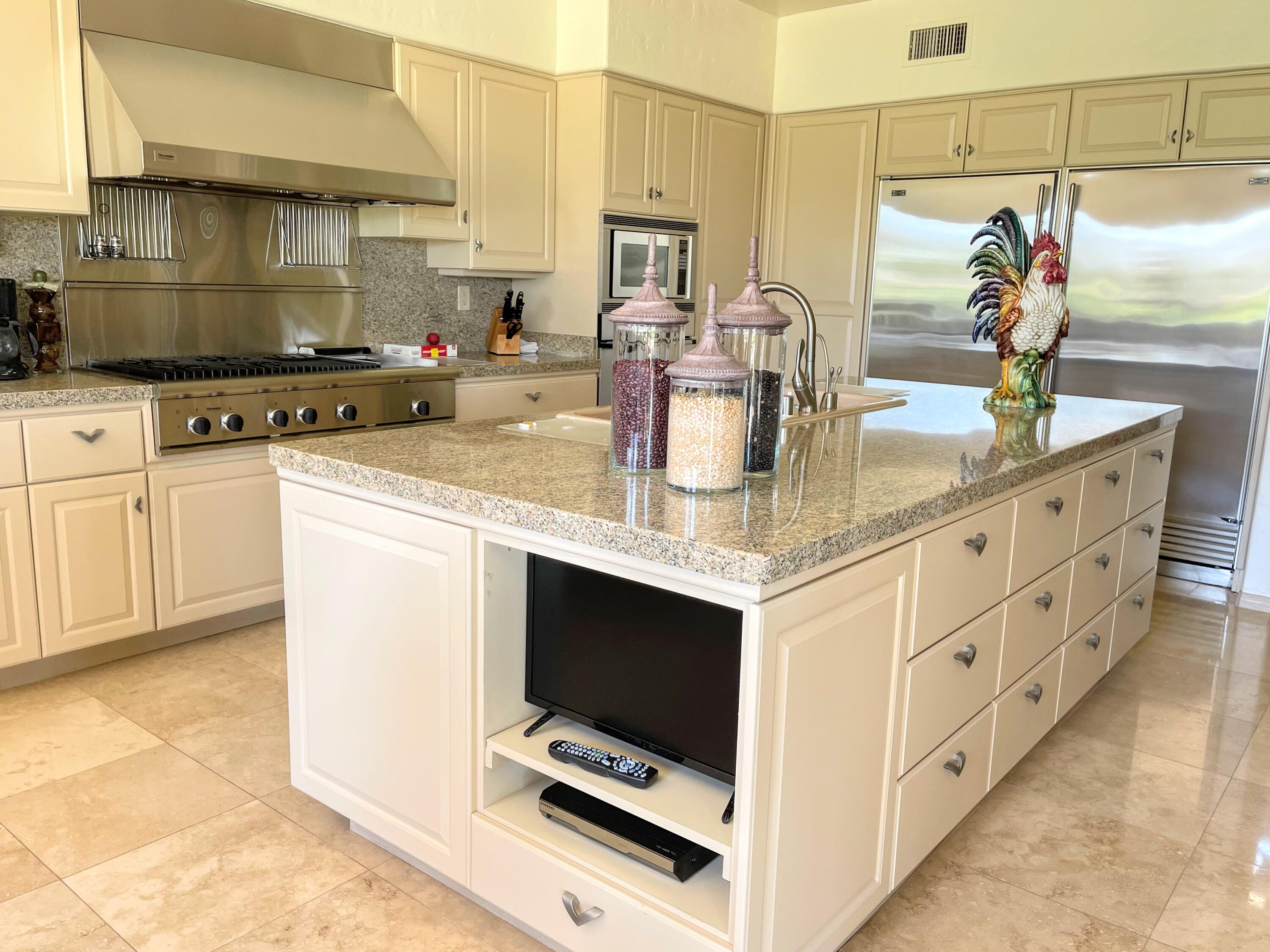 Exceptional offering at The Lakes Country Club.  This turnkey furnished home is one of a kind ! The Santa Fe model has been expanded to 3776 S.F. with 5 bedrooms and 5 1/2 bathrooms including two grand bedroom suites (each with a steam shower) and 3 other bedrooms each with an ensuite.  The kitchen is an entertainer's delight.  It is equipped with professional style appliances - two Subzero 36' refrigerators and one 36' Subzero freezer, a separate icemaker, and a 42' Thermador range-top with hood.  The oversized island is ideal for entertaining, family gatherings or for the chef in you to experiment with new dishes!  The home is equipped with the original 'smart home' technology -lutron.  From a command center, you are able to control all lighting, sound and window shades.  Current owners have enhanced the smart home features with wifi thermostats(newer HVAC system and water heater as well), ring doorbell and wifi garage door opener system.  Located on a premier lot with westerly mountain views and a private gate from the side yard to the neighboring community pool and spa.  The Lakes CC has undergone an extensive update including a 13,500 state of the art fitness center.  HOA Dues include all amenities except golf.