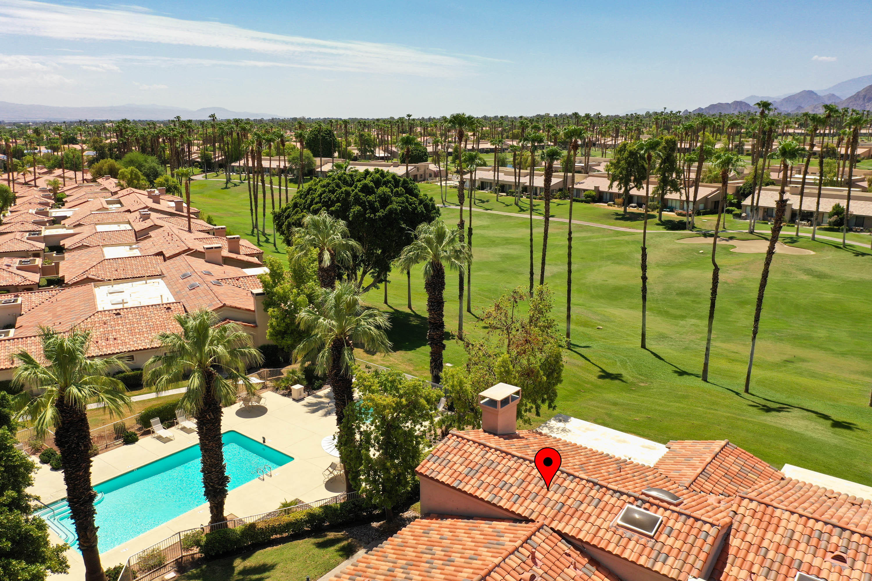 This incredible Palm Valley Country Club Condo has everything to please the most meticulous buyer who expects quality and loves perfection! The South facing patio has views of the 18th hole of the Ted Robinson Championship Golf Course, a lake and the beautiful Southern Mountains. This is the most sought after direction in the desert. There is warm winter sun present here all season. Spectacular mountain sunsets and lingering twilight skies are absolutly gorgeous. This home offers 2,489 SF (EST.) of spacious and gracious living. Soaring vaulted ceilings, tile flooring everywhere and three bedrooms, all with private baths plus a guest powder room. The stunning kitchen has granite countertops and stainless steel appliances all framed by rich, dark cabinets and a stool height island that is ideal for entertaining. The huge, open great room has a cozy gas fireplace for those cool winter evenings and great views to the golf course and distant mountains.  Additionally, it has its own private entry courtyard and a two car attached garage. This single level home is just a few steps to an amazing Clubhouse that features a fitness center, tennis, a gigantic resort style swimming pool and spa, the pro shop and so much more!