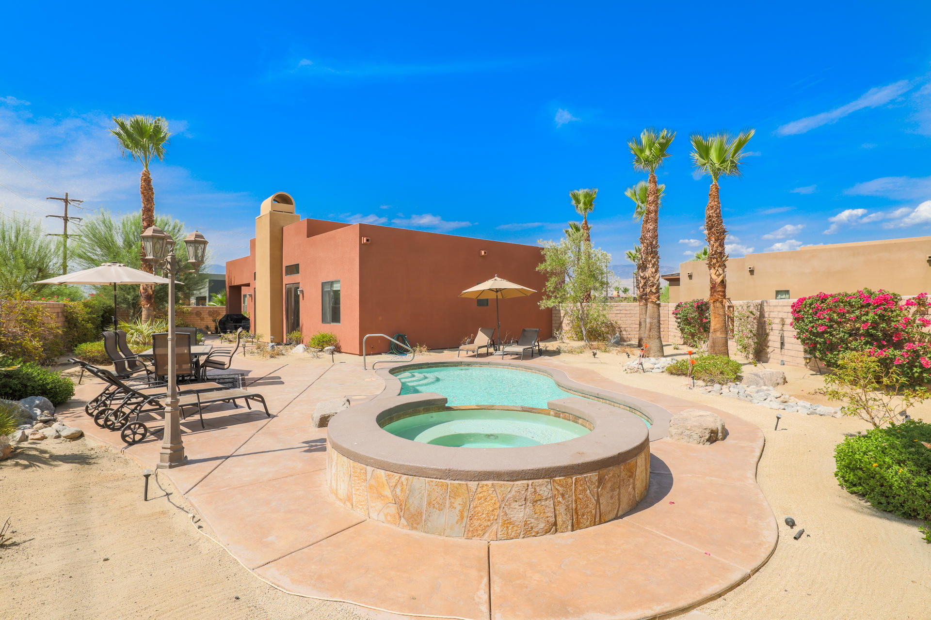 Located in the Semi Custom tract of Pele Place in North Palm Desert this 3 bedroom 2 bathroom pool/spa - Solar home is the epitome of Palm Desert Living! The interior design boasts 12 & 10 foot ceilings, all 8 foot doors, huge contemporary open floor plan, double door entry, 3 sets of French doors (all lead to the backyard) & split bedrooms making the master suite private from the 2 other bedrooms. The interior features big tile floors (laid diagonally), big base boards, granite counter tops/back splash, all high end appliances & pantry. The master bedroom features a double door entry plus a private slider to the backyard w/ a private patio. The master bathroom shows off an all marble shower, tub, & double vanity counter top w/ a big walk in closet. The home sits on a huge lot just under 12,000 square feet in the back of cul de sac. The backyard is a private paradise that shows off a Custom pool, spa, decking, & some mountain views! Welcome & enjoy life at your new Palm Desert home!!!