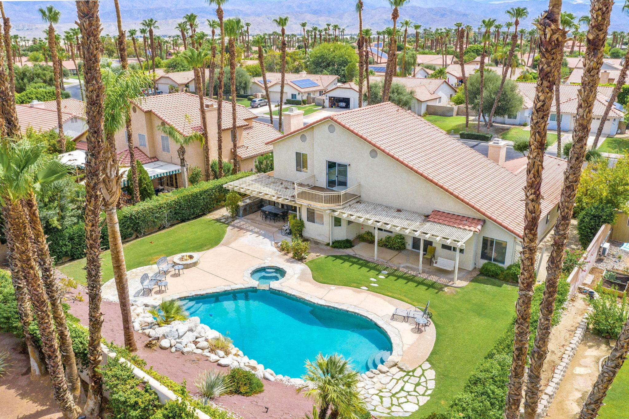 Welcome to this fabulous home in Palm Desert located behind the gates of desirable Regency Palms.  This beauty features 4 bedrooms & 3 1/2 baths inside the home with an attached 5th bedroom casita.  Enter into the double door entry where you are greeted by a massively entertaining living space with formal dining area, large living room & step down wet bar with picturesque views of the amazing backyard.  Spacious master suite features double doors, cozy fireplace, walk in closet, dual vanities, soaking tub & is separate from all other rooms for complete privacy.  Gourmet kitchen has upgraded cabinetry, stainless steel appliances, granite counters & is assisted with the cutest built in nook perfect for morning breakfast.  Great room off of the kitchen is warm & inviting with gorgeous wood built ins that compliment the rich tones throughout the home.  Upstairs you will find 3 bedrooms & 2 baths with GORGEOUS views of the pool, golf course & mountains.  This entertainers dream yard is extensive with every detail from the outside shower to the built in BBQ to the fire pit over looking the amazing pool, spa & rock waterfall.  This beauty shows pride of ownership from the minute you pull up to this 2800 sq ft space with almost 13,000 sq ft lot.  Come fall in love with this one-of-a kind lot that is in the ideal location close to parks, schools, shopping & entertainment.  You won't be disappointed!