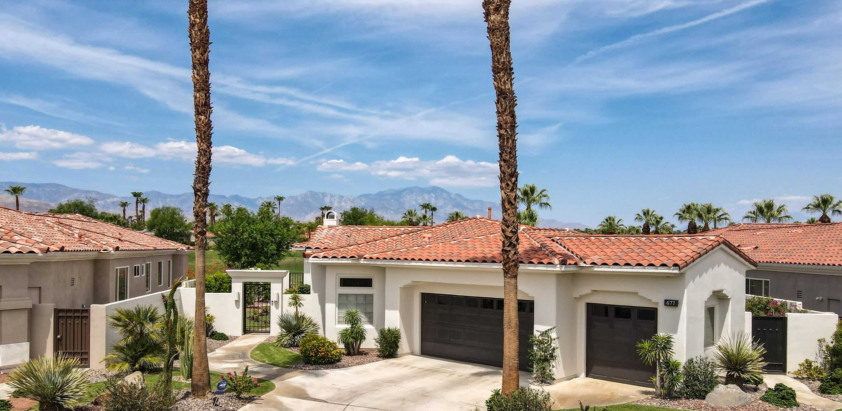 Very Desired Indian Ridge Country Club Popular Ocotillo 2 home located on a private West facing oversized panoramic view lot!  Boasting an open floor plan with soaring ceilings, this recently remodeled light and bright 4-bedroom and 4-bathroom home takes advantage of the indoor/outdoor lifestyle due to the many windows and glass sliders. Tons of recent updates include modern porcelain tile throughout, new baseboards, 70+ LED recessed lights, electric color changing fireplace in the family room, brand new stainless steel KitchenAid & LG appliances, whole house water filtration & softener system with reverse osmosis drinking water system in kitchen, Hunter Douglas remote blinds, freshly painted cabinets in the kitchen and laundry room, all new custom cabinets with quartz counter tops in the bathrooms, completely renovated powder room with Italian made porcelain countertop & sink. The owner has converted the dining room into a 4th bedroom/private office to maximize the interior space and provide another sanctuary. Overlooking the green off the 14th hole on the Arroyo Course, the spacious outdoor living area has spectacular panoramic mountain views and is large enough for a private pool. The exterior of the home includes new exterior paint, brand new landscaping and irrigation, outdoor lighting and room to build a casita!  Additional upgrades include two tankless water heaters, newer A/C unit, state of the art security and custom closet organization.