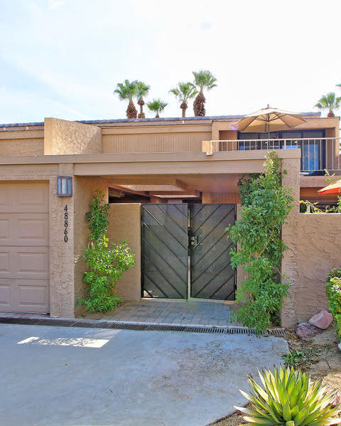 This 3 bedroom 3 bathroom home is a remarkable gem within the stunning desert landscape of Ironwood Country Club. The indoor and outdoor living spaces offer gorgeous views of Eisenhower Mountain with 2 additional courtyards downstairs and a balcony upstairs.  The open concept floor plan allows the kitchen and living areas to frame the views through a wall of sliding glass doors.  The kitchen has plenty of cabinets and a breakfast bar which is perfect for entertaining your family and guests.  The kitchen, with its own sliding glass door, gives you access to a private sitting area.    Downstairs has one large bedroom connected to a side courtyard with a ''peek-a-boo'' view of the manicured surroundings.  There is a luxurious steam shower located in the bathroom downstairs. Each of the two large bedrooms located upstairs have their own updated ensuite bathrooms.  A balcony with captivating views of the Sonoran desert is attached to the third bedroom.    There is a small landing leading from the staircase that makes a great office space for those who work from home.  Downstairs, a full size washer & dryer room completes all the amenities needed.     This property has a very private feeling and combined with the Ironwood outdoor activities of swimming, golf, tennis, restaurants and hiking trails makes this home a very special place to enjoy the desert-resort lifestyle.