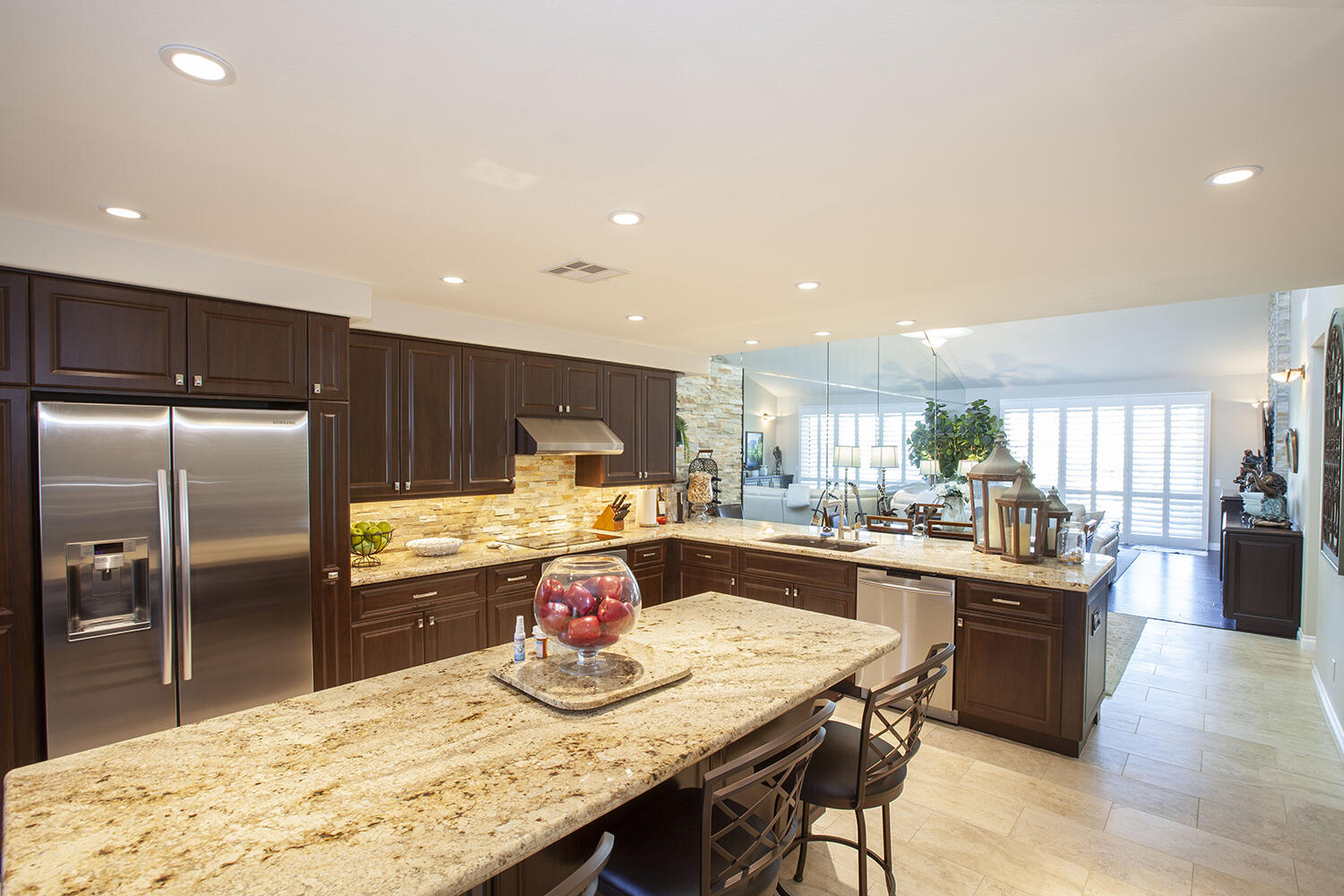 Everything about this beatiful condo will amaze you!  From the minute you see the pavers in the driveway, walkway and front courtyard to the open and spacious remodeled  condo.  No details have been missed.  This is a Palm Plan with 2 bedroom, 2 baths and a den or office that has been remodeled with high quality cabinets, fixtures,stone work, granite and stainless steel appliances in the kitchen.   The bathrooms feel like you're at a spa.  The living room is comfortable and has a beautiful electric fireplace for you to enjoy.  You can relax on your private courtyard patio that has a sail for shade and a top of the line BBQ for you to prepare wonderful meals for friends and family OR enjoy the fairway patio with endless views of the golf course, mountains and our beautiful blue skies.  This home is perfect for a full-time resident or a weekend get-away.  Palm Valley has so much to offer:  2 Ted Robertson golf courses, a 100,000 sq. ft. clubhouse, a day spa, fitness center, tennis and pickleball courts, 46 swimming pools and so much more.  Come take a look at your new desert home!!!