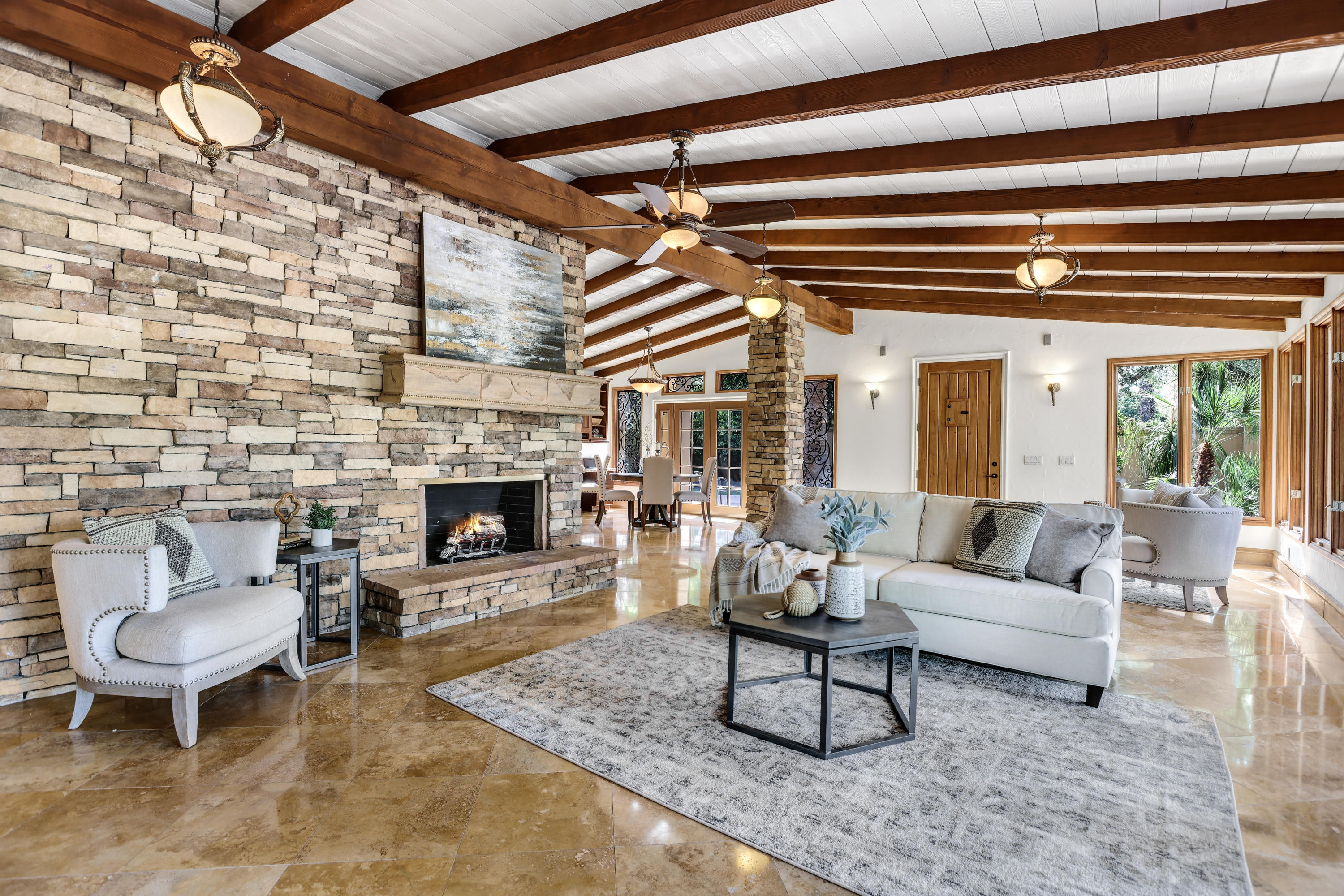 Major Price Reduction!  Rumored to have been originally built for golf legend Ben Hogan, this home was remodeled and expanded in 2006.  Now a true compound for friends and family to gather.  Perched on a north facing, more than half-acre lot with ''forever'' fairway views of prestigious Tamarisk Country Club golf course this home exudes quiet luxury and total privacy.  The main house boasts an open gourmet kitchen, formal dining room, formal living room, breakfast area, wine room and separate wet bar.  Attached casita has separate kitchen, living room, 2 additional bedrooms, lounge, and private courtyard with outdoor fireplace.   Outdoor entertaining area has a separate cabana, bathroom and outdoor BBQ, freeform pool and spa.  The possibilities are endless - think family compound, separate in-law suite, separate rental unit because the possibilities are endless.  No homeowner's association and no dues.  Can be your primary dream residence or second home in prestigious Rancho Mirage.  Exceptional offering.