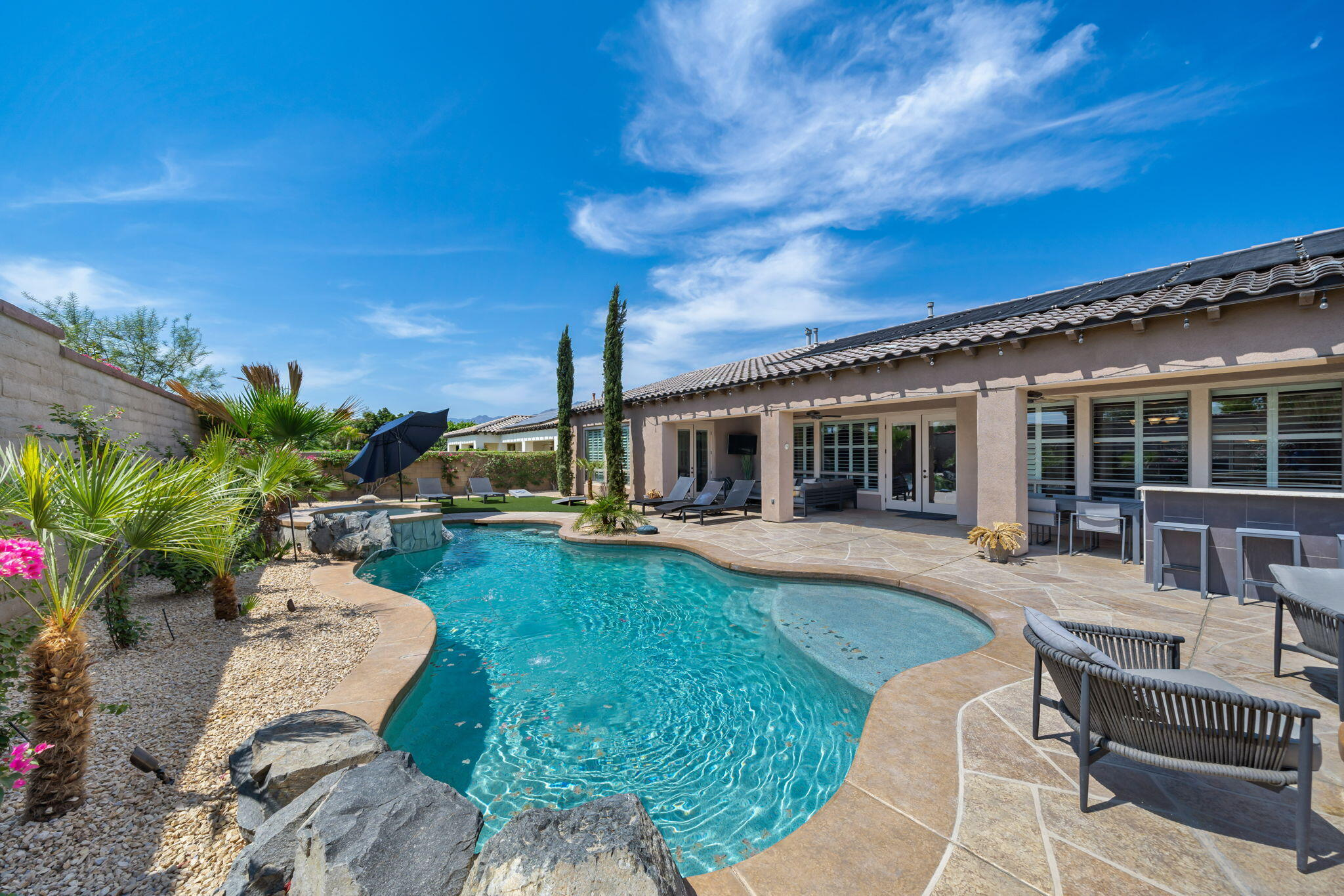 Here is your chance to buy in the highly sought-after community of Montage at Santa Rosa. Montage is located within walking distance to Coachella and Stagecoach...and the HOA allows SHORT-TERM rentals...which allows for incredible money-making potential. This popular floor plan consists of 5 bedrooms (including a casita), 4.5 bathrooms as well as a game room. Offered fully, furnished...this is the opportunity you have been waiting for! The backyard highlights include a sparkling pool and spa, misters, putting green, fire pit, grassy play space and an incredible outdoor kitchen. The back yard is so amazing, it was featured in the summer issue of Sunset Magazine! These Montage properties fly off the market, schedule your private tour today. Showing days/times are limited, as this popular property has guest stays booked throughout the rest of the year.