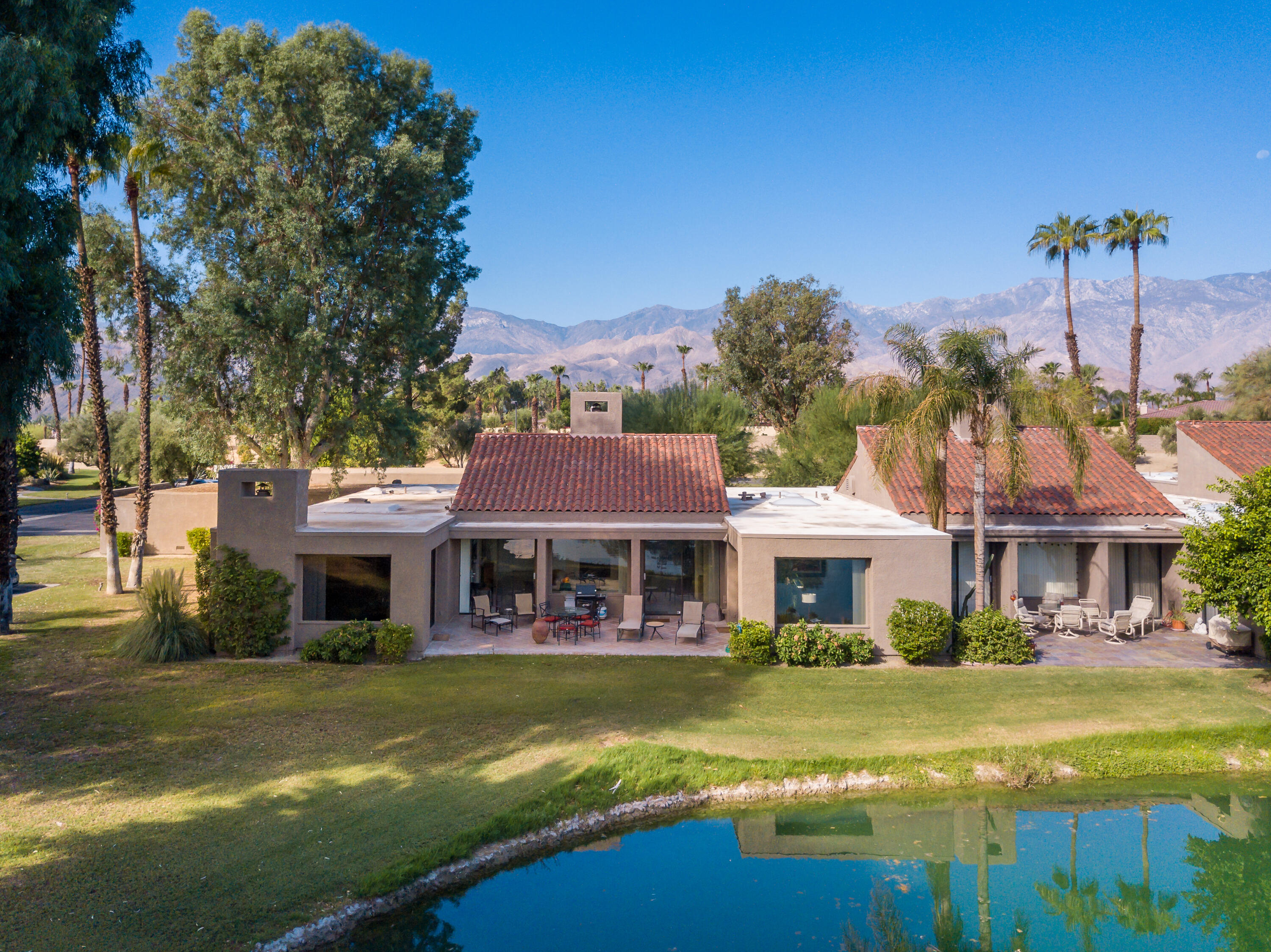 Price reduction - Located within the beautiful gates of Mission Hills Country Club in Rancho Mirage, this lovely 3 bed / 3 bath - 2,727 sq. ft condo is an end-unit with unobstructed lake views!  Recently remodeled & upgraded. Large kitchen, granite counter tops, new appliances, new lighting, new carpet and tile.  Being sold turnkey furnished.  Close to community pool & spa.  Mission Hills Hoa includes landscaping, cable tv, guard gate, community pools, exterior maintenance of roofs and painting.  Plus 3 championship golf courses - Arnold Palmer, Pete Dye Challenge, & Dinah Shore Tournament.  Minutes away from Palm Springs Airport, Eisenhower Medical, The River and Agua Casino. Private golf, social and tennis/gym memberships are available at the Mission Hills Country Club, a golf cart ride away.