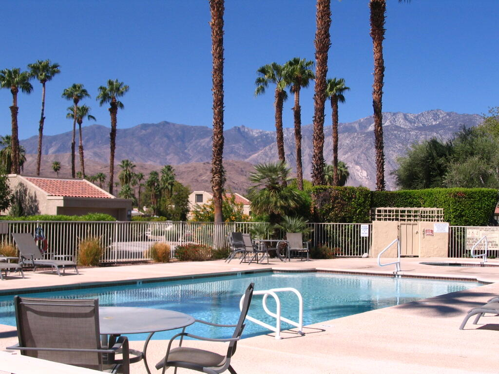 Views!  Views!  Views!  From your private patio, with a desirable poolside location, enjoy the breathtaking southwest mountain views.  A must see single story, end unit VILLA in gated Cathedral Canyon Country Club with parking conveniently located just steps away.  Sunny and bright with lots of windows, soaring ceilings, mirrored bar area, ceiling fans.  The kitchen offers abundant storage with 2 pantry areas plus a French door opening to the patio.  The master is large with a window to the view; the master bath offers dual sinks, a wall of closets with mirrored doors & closet organizers and a large walk-in shower.  The guest bath is accessible from both the guest room and the hallway.  The full-size washer/dryer is located in the hall closet plus an attached exterior storage closet is large enough to store bicycles, etc.  Enjoy all the amenities-clubhouse with restaurant and lounge, tennis, golf.  Ideal as a primary residence, second home or rental.