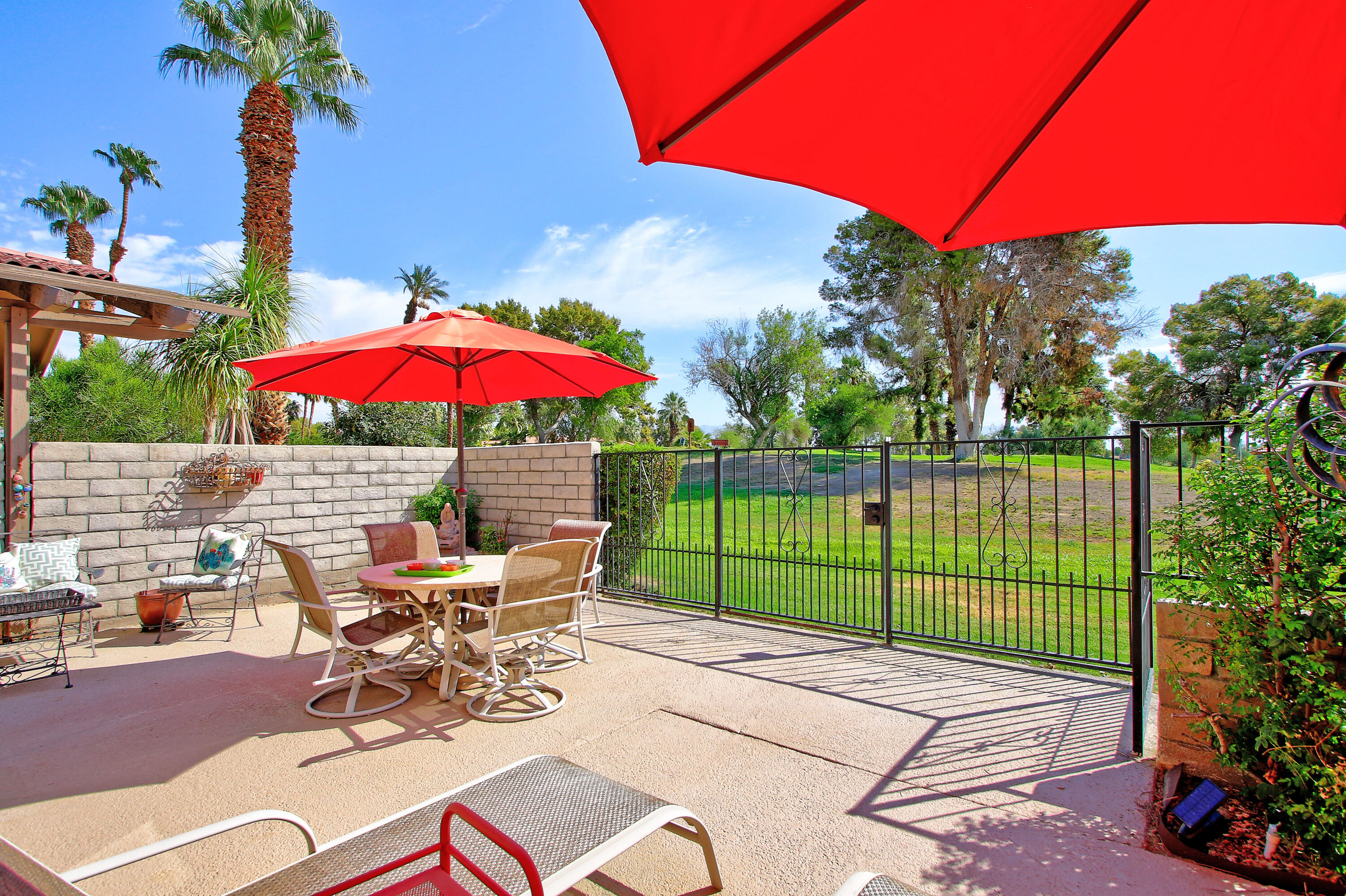 This pristine golf course condo in Indian Palms Country Club is an ideal vacation home or full-time residence in beautiful Coachella Valley.  Partially furnished, this golf course home overlooking the 1st Tee of the Indian Palms Mountain course, offers a large patio, with bubbling fountain and comfy chairs, offering the ideal patio setting for sipping your morning coffee while watching golfers tee off, or having Cocktails with friends at Happy Hour.   Inside, the condo boasts many lovely features, such as newer bathroom commode and vinyl flooring in the Master Bath; a closet with built-in organizers; an ample kitchen with Breakfast Bar, top-of-the-line water filtration system, newer range, vinyl floors, pantry cabinet and tons of storage; 6-month old HVAC and Water Heater systems; and much, much more!  In addition, this condo is well-located in walking distance to Empire Polo Grounds, where Coachella and Stagecoach are held annually, in addition to world-class polo.  Shown by appointment only, this beautifully-maintained property is move-in ready, and is sure to sell quickly, so please make an appointment to see it now!
