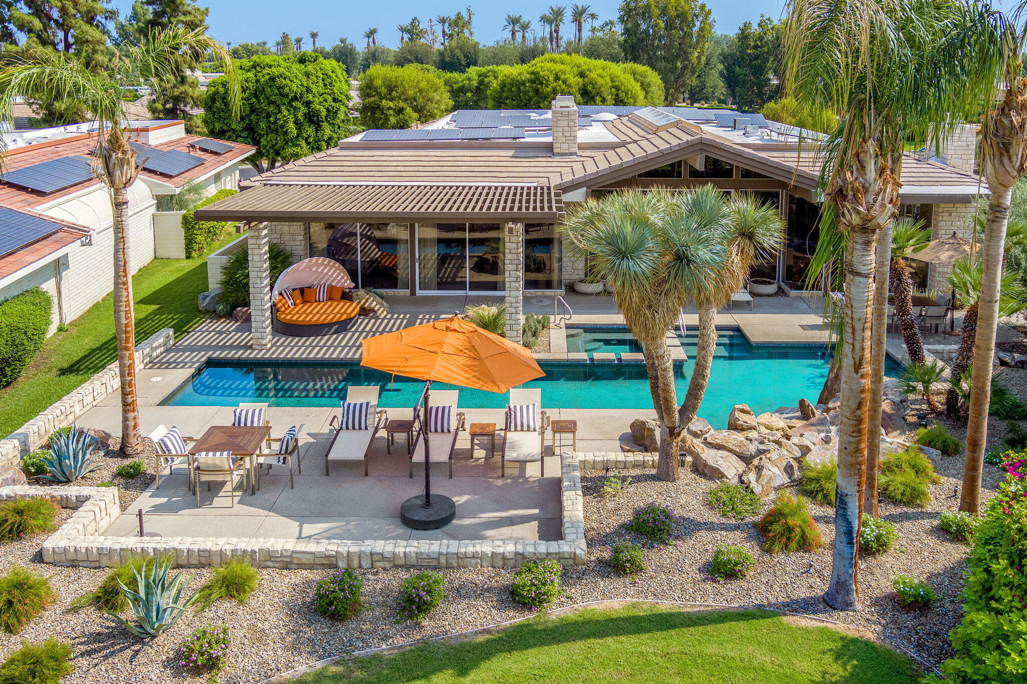 This is a highly treasured 4BD/ 6BA Shaughnessy floorplan located in The Club at Morningside. Recently remodeled with a contemporary flair, this luxurious free-standing home offers picture perfect views of the Santa Rosa Mountains to the southwest and is situated beside a beautifully manicured lake.   Gorgeous attention to detail throughout! The dramatic entry leads into a light filled living room with sky-lit vaulted ceiling, walls of glass infuse beautiful views into the living space. Details include a full bar with large capacity wine refrigeration system, lots of seating, stacked travertine stone fireplace wall, porcelain floors, water filtration system, newer HVAC, savant audio system and solar.    An opportunity like this rarely comes on the market! This is a private entertainer's dream with fabulous outdoor amenities. The magnificent wrap around veranda offers side and rear patios, security for your pet, an amazing outdoor Chef's kitchen with wood burning multi layered meat grill, two built-in gas BBQ's, plus a smoker. Lots of space to relax with family and friends in the large lap pool or oversized spa.   Fabulous chefs' kitchen offers quartz counters, chill room pantry, oversized eating area with fireplace and custom cabinetry.   The lavish master suite features a fireplace, dual baths, and walk-in closets. This home offers a large in-law guest suite with sitting room! Two other large guest bedrooms all ensuite.    Don't miss this opportunity!
