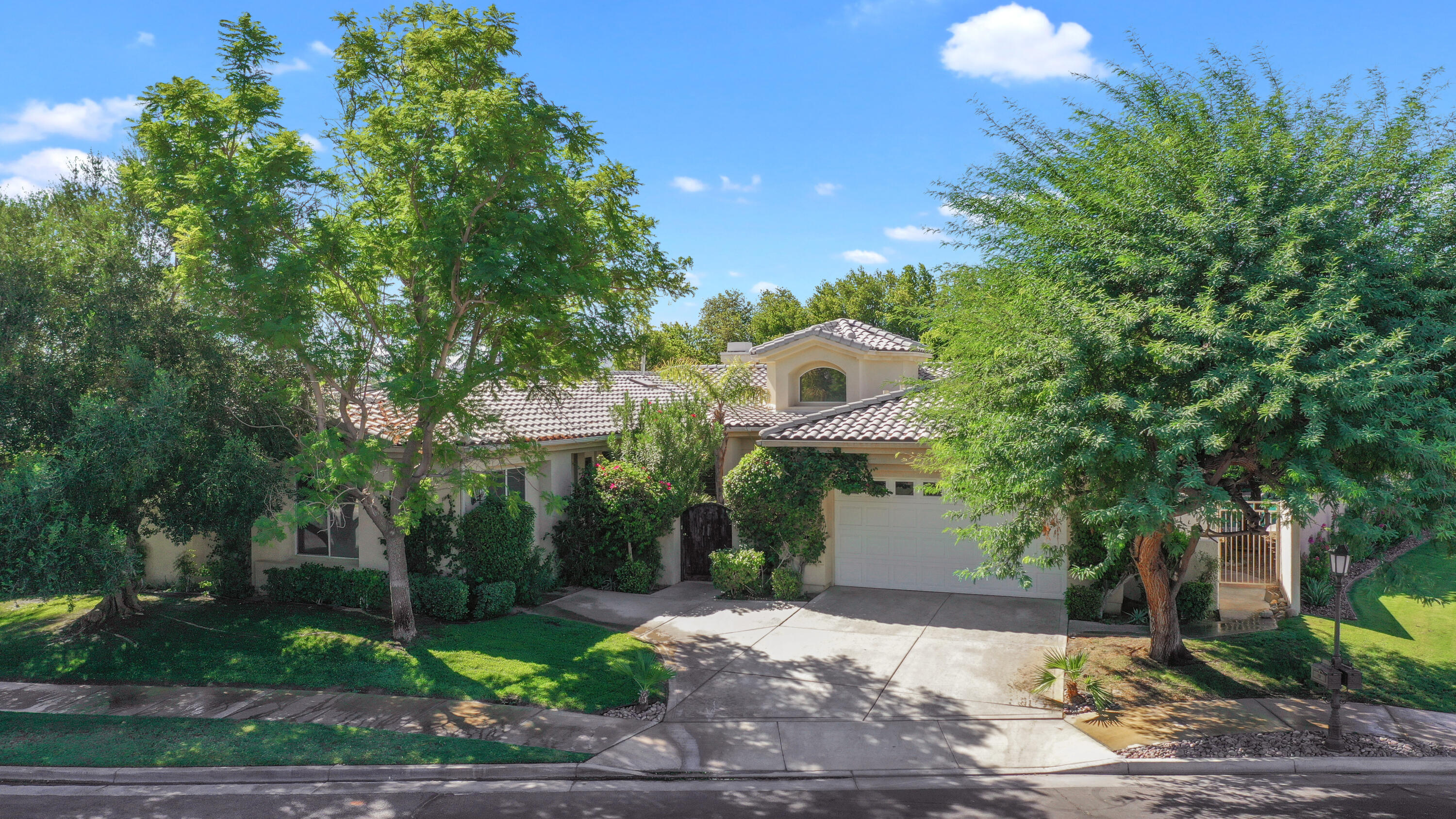 This spacious 5 bedroom/4 bath home is in the prestigious gated community of Victoria Falls.  Nestled deep in the community, it is tucked away at the end of a cul-de-sac.  This popular Duchess model is an open floor plan offering a large family room with fireplace, custom built entertainment center and sliding doors open to the back yard, and it opens to a gourmet white-cabinet kitchen with granite counter tops, a breakfast nook and a breakfast bar. The separate large living and dining area offers multiple entertainment areas  and features French doors. This light and bright home features high-end shutters throughout the entire house.  The oversized master suite includes a master bath with a soaking tub, shower and large walk-in closet.  The main house features 3 more bedrooms and 2 more baths. The attached casita offers an additional bedroom and its own private full bath. The south-facing back yard includes a sparkling pool and spa, back patio for entertaining, and a built-in BBQ, offering multiple entertaining areas for family and friends.  For the sports aficionado , the home is just a short walking distance to the tennis & basketball courts. The house has been freshly painted, has a new HVAC system and a new pool heater.  Victoria Falls is conveniently located, just 5 minutes from El Paseo, the valley's own Rodeo Drive, 5 minutes away from the entertaining/dining venue of The River, and 10 minutes from the Palm Springs airport.