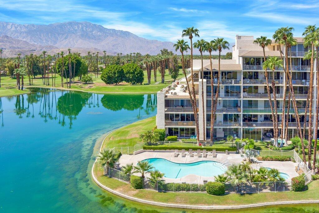 Panoramic  lake, fairway and mountain views are enjoyed from the living/dining room, both bedroom suites, den and private terrace.  This 2BR, 2BA with 1974 sq ft includes a spacious DEN with access to the terrace.  High ceilings and walls of floor-to-ceiling sliding glass doors expand the natural light and views enjoyed from within the interior space.  The kitchen details include granite countertops, double ovens and ample cabinet storage.  The private terrace offers an abundance of space for outdoor dining and relaxation.  Desert Island offers Guard gated Security,  swimming pools, spas, tennis, pickleball, fitness center, paddle boats and expansive greenbelts with beautiful landscaping.  The HOA includes, Water, Trash, A/C, Gas, Cable TV, Internet and so much more.  This prime location in the heart of Rancho Mirage, offering privacy and forever views, is truly unique.