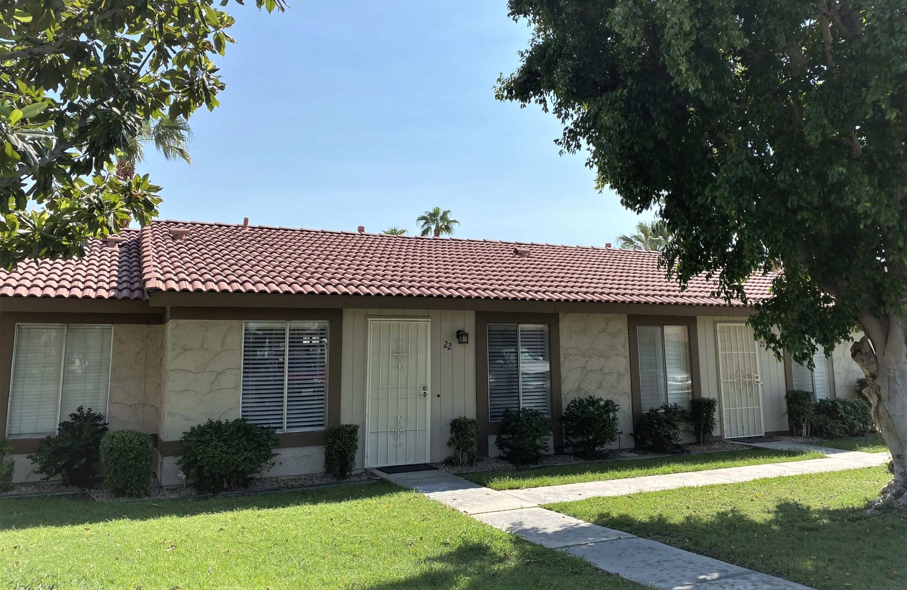 Welcome to Indian Palms in Indio.  Beautifully updated 2 bedroom / 1 bath condo at 616 sq. ft., fully furnished and ready for you to move in.  Unit features an open floorplan combining living, dining, and kitchen areas with vinyl plank flooring throughout for a modern look and easy to maintain.  Kitchen features an amazing custom blue acrylic countertop, hanging pendants, and open shelving providing an open spacious feel.  Bedrooms have ample space with primary bedroom having a built-in closet and guest BR having a cubby storage system.  Convenient location to the pool and public laundry facility. Indian Palms is the prime location for walking to the Coachella and Stagecoach festivals as well as close to biking and hiking trails, casinos, restaurants, and shopping. In addition, you have low HOAs and low cost for electricity with Imperial Irrigation District!