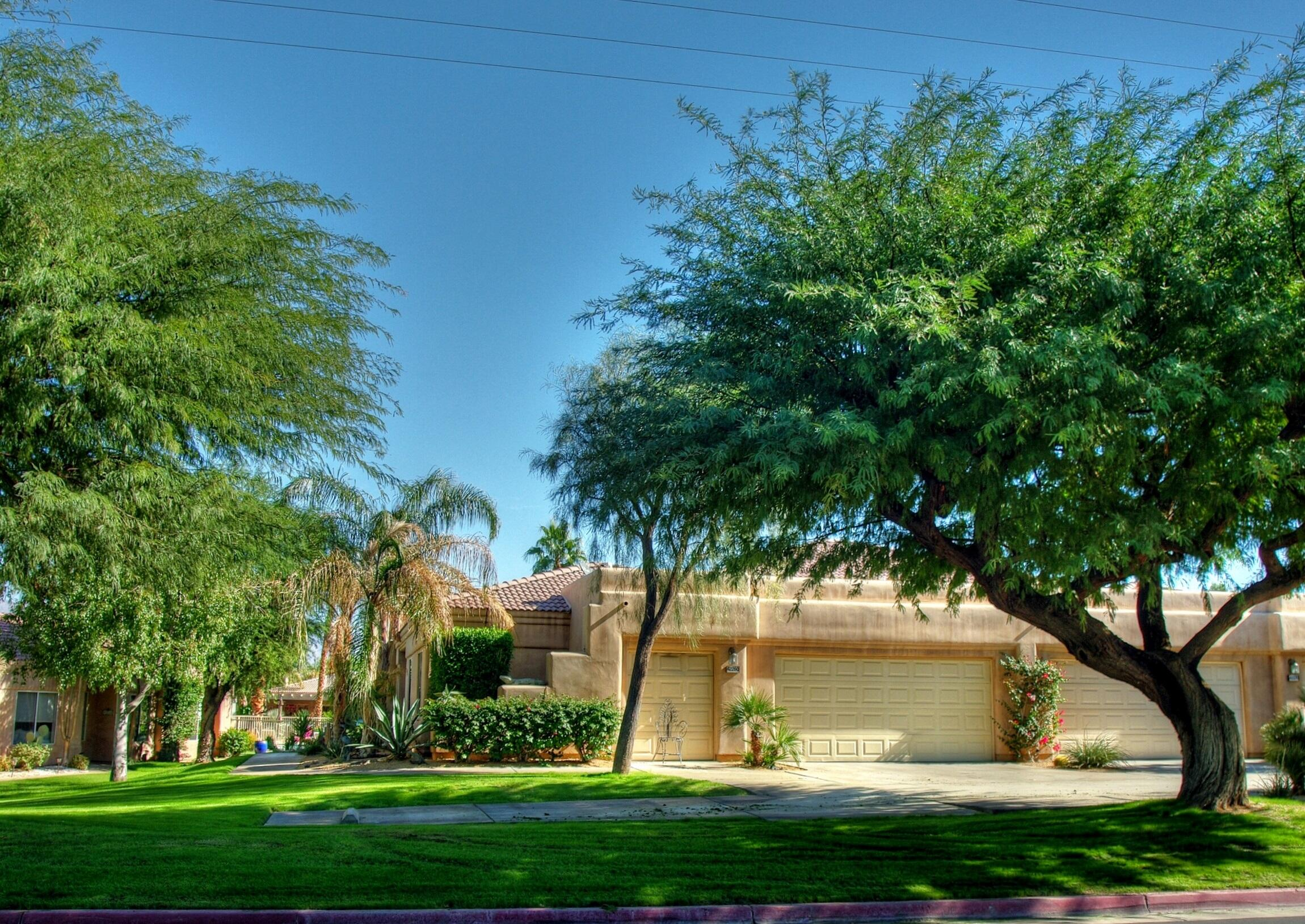 This highly upgraded 3 BR, 2 BA condo is one of twenty paired patio homes in 'The Greens' in Bermuda Dunes CC! With 1972 sf of living space, the large, open living room and formal dining area feature tile floors, stack stone fireplace, Plantation shutters and French doors - with views and access to the community pool/spa. The kitchen offers bull-nose granite counters, custom cabinetry, stainless appliances, and cozy breakfast nook. The large master suite features high ceilings with clerestory windows, separate seating area with French doors leading to the covered patio. The ensuite master bath has a double vanity, step-in shower, and large walk-in closet. The 2nd and 3rd bedrooms are perfect for family or overnight guests. Enjoy the beautiful greenbelt and mountain views from the covered patio - complete with firepit and BBQ cook center. The large attached 2-car garage + golf cart garage has direct access into home. IID for lower electric. Security HOA of $199 includes cable TV with two boxes w/Showtime & HBO, plus internet (with Spectrum) plus security. Condo HOA of $499 includes gardening, pool & spa, water & trash. Minutes away from world class golf, tennis, dining and entertainment!