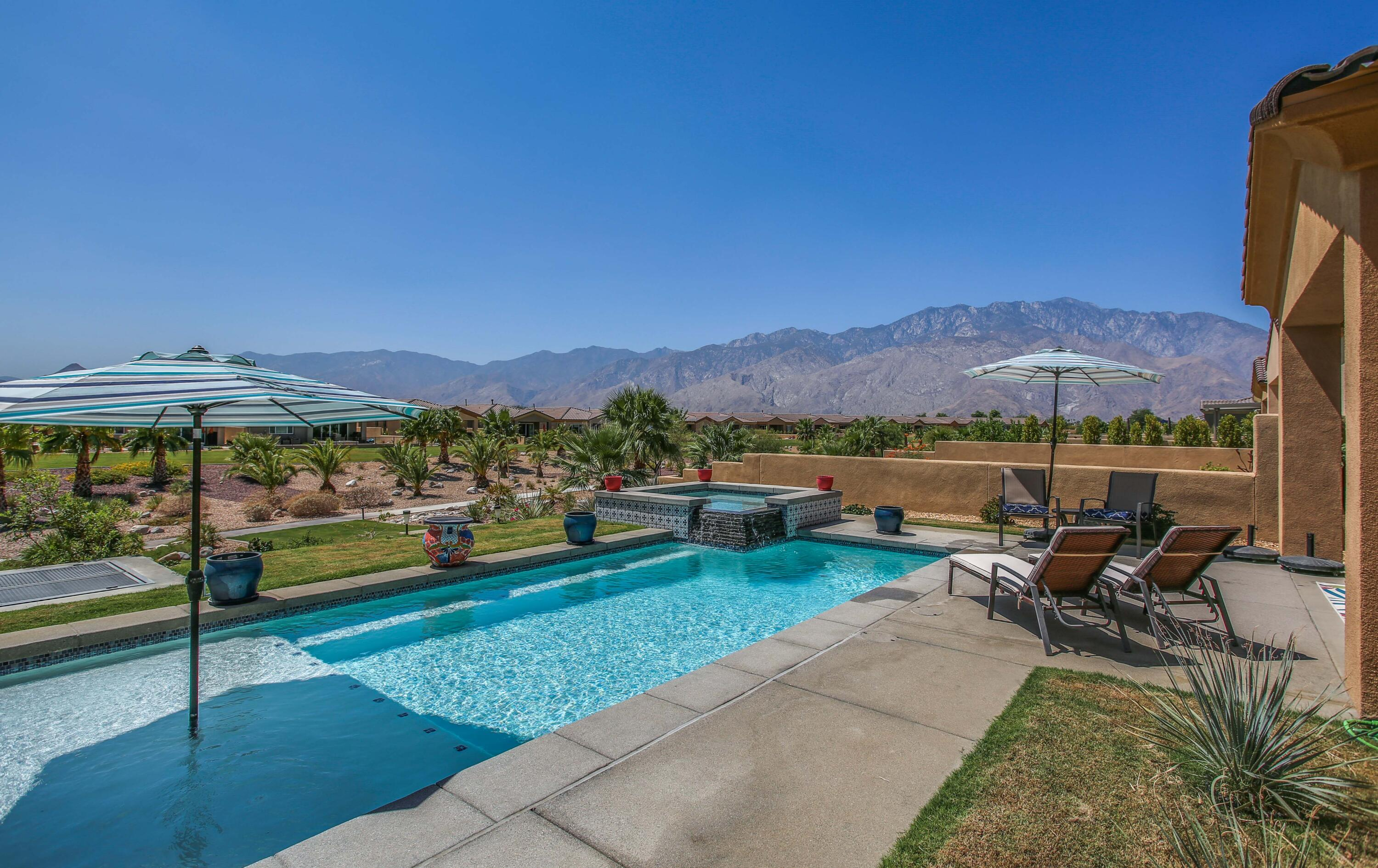Breathtaking views of the incredible landscaping, framed by the majestic San Jacinto mountains. This open floor plan, turnkey furnished home features three bedrooms and two and a half bathrooms. Prepare a gourmet creation in the gorgeous, fully equipped kitchen that is open to the dining and living room.  There is a beautiful fireplace to enjoy your nights.  The master suite has 180-degree views of the mountain range and greens. The junior suite is quite spacious and connects to the third bedroom via a Jack and Jill bathroom on the opposite end of the home. Enjoy a cocktail by the south facing back yard with a salt water pool, stargaze while soaking in the hot tub or take a relaxing walk around the ¾ mile walking path located just off the back yard.  This home is a top income producing vacation rental property which has about $50,000 in rentals from Nov - April that could transfer to the buyer. Desert Princess Resort and Country Club is a guard gated community. The resort offers 27 holes of amazing golf, driving range, tennis, pickleball, racquetball, full-service spa, and a newly designed fitness center. All  owners have access to these amenities including the Clubhouse grill, bar, lounge, and dining room. Enjoy your own private salt water pool/hot tub or perhaps experience one of other 33 pools in the resort.  This home has amazing views from this premium lot.