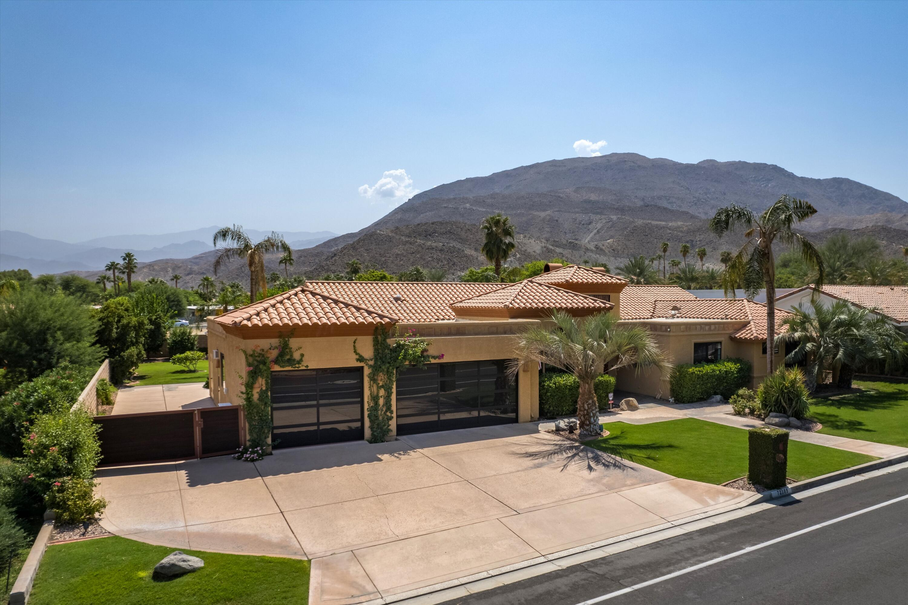Sensational view, large lot, desired location. Three-bedroom, 2.5 bath, two offices with built ins, custom home, offers all the distinctive architectural uniqueness one looks for. Custom Saltillo floors enhance the Spanish feel to the home. Unique family room ceiling boasts ten solid wood beams separated by diagonally placed grape sticks. Graceful arches, tall ceilings, sculptured plaster walls, delightful colorful kitchen with remote controlled window coverings. Separate pantry, hallway & kitchen cabinets provide extensive storage space. Soft drink refrigerator, separate icemaker, ceiling fans & shutters throughout. Large bedrooms, exceptional master bath with oversized jacuzzi tub. Custom surround fireplaces in family room and master bedroom. 40-foot covered patio with misting system boasts new Lincoln tiled floors & ceiling fans. Pool/spa deck newly resurfaced with Marbilite, large, landscaped backyard with lemon & orange tree, many Bougainvillea bushes. RUV concrete pad side of building. Garage offers 6 double storage cabinets & work bench, separate air conditioner, 2 cars plus golf cart. New roof 2020 & new furnaces in 2016. 40 paid panel solar system. New glass garage doors. This home is within minutes to The River & it's many restaurants & movie theater. Starbucks, Hobby Lobby and other shopping all in the adjacent shopping center. This stunning home has been nurtured & pampered. 3700 square feet, lot approximately 1/2-acre, White Sun area, Rancho Mirage. Call Today!
