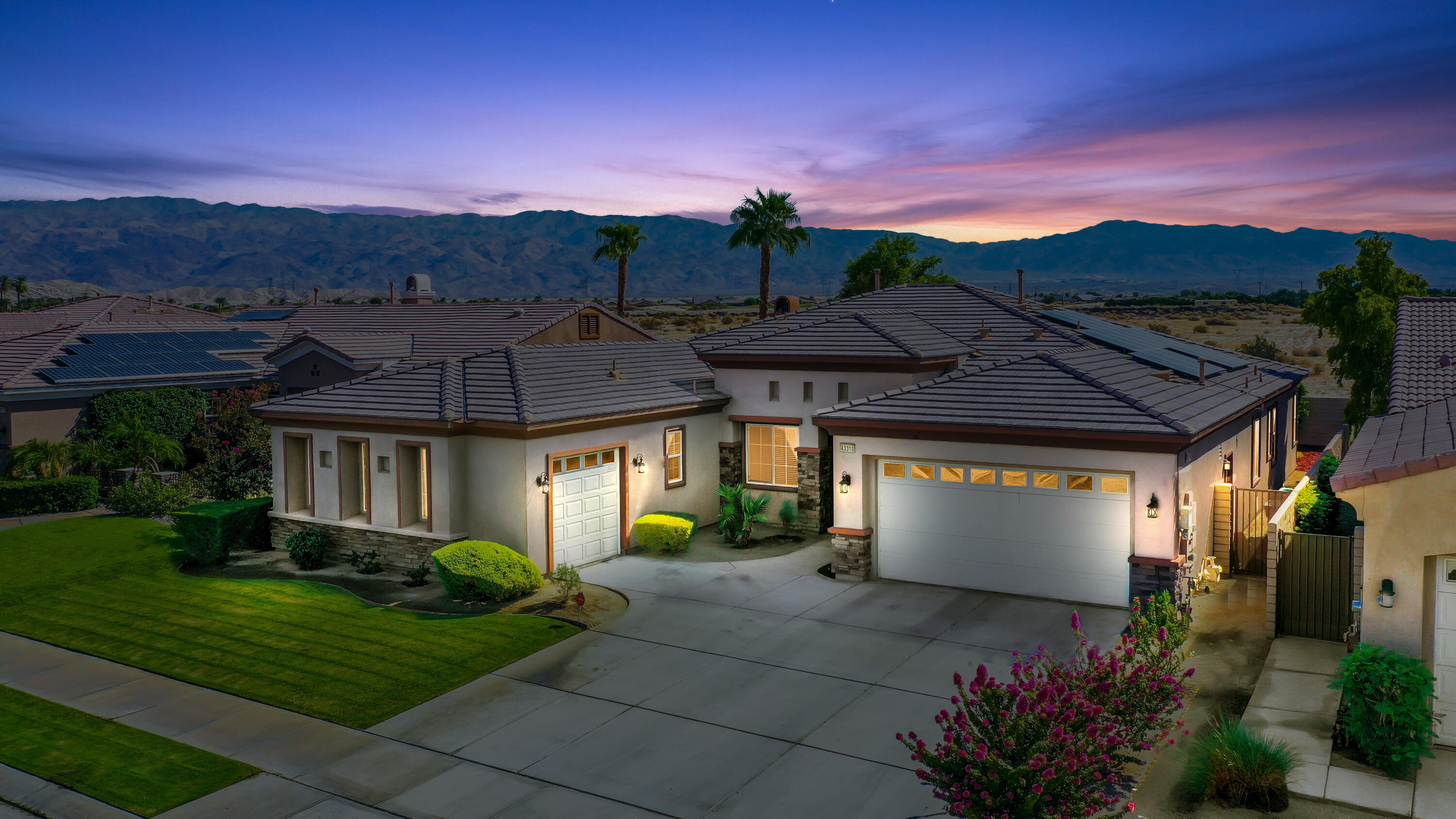 Located in the scenic guard gated community of Terra Lago is a solar home with one of the largest floor plans in the community, featuring 4 bedrooms, 3 bathrooms, and 3,142 sf of living space.  The inviting combined living room and dining area features 18-inch tile floors throughout, high beveled ceilings with recessed lighting, and windows that overlook the back patio.  Entertaining is a breeze in the family room, with its decorative stone fireplace and plenty of space for an entertainment center. The open chef's kitchen features bull-nose slab granite counters, stainless appliances, loads of cabinet space - plus a pantry, work desk, and separate eating area. Enter the huge master suite, with its beveled ceilings, wall-to-wall carpet, and sliders that open directly to the covered patio.  The master bath has dual vanities, tub, glass step-in shower, and large walk-in closet. The 3 additional bedrooms have walk-in closets, offering space, comfort, privacy and easy access to the 2nd full and 3rd ¾ bathrooms. Extras include a laundry room, 3 car garage, solar panels and low HOA Fees. Outside, enjoy the private yard on the large covered patio.  Take in the lovely lake and mountain views from the front and back yards. IID and financed solar mean low electric bills. Amenities at Terra Lago include cable, Internet, clubhouse, events room, gym, pool, spa and no-contact lake.  Terra Lago is only minutes away from shopping, dining, golf, tennis, casinos, and entertainment.