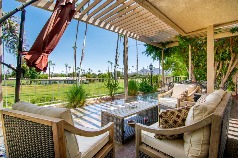 Ideal location steps from the Rancho Las Palmas Resort and Spa and The River.  Rare opportunity to own this one-of-a-kind modified 300 plan with raised views over the 5th/6th/7th and 8th Fairways. Oversized slate patio viewing dramatic fairway, resort and southeastern Mountains. Indoor laundry off the large primary bedroom with two additional bedrooms; one easily converted to den or office. The centerpiece of the home is the Dining Room which features a solarium roof that opens on the western side for additional ventilation on ''cooler'' evenings and a stunning artisan-crafted plank wall. The great room is expansive and perfect for entertaining, and the remodeled kitchen includes glass fronted cabinetry, granite countertops and travertine floor with stone inlay. There is a large walk-in closet in the master, plus a pocket closet in the master bath. With a finished attic, a golf closet, and a wall of cabinets leading from the laundry room to the garage, there is a place for everything. See Document section for Floor plan, Country Club Info, Seller Disclosures and additional property advantages.  Furnishings, as well as the golf cart are  included. Artwork is excluded.