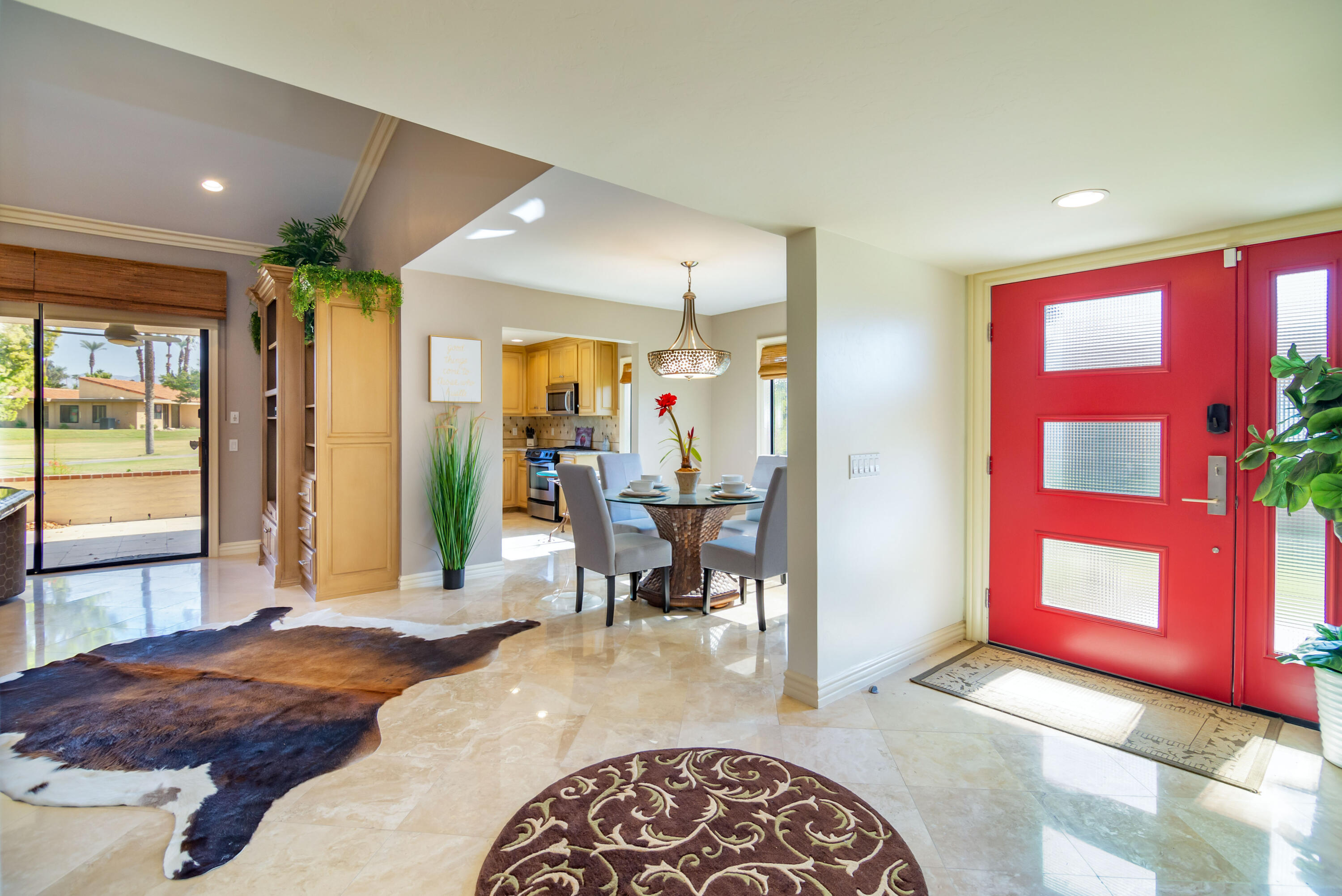 This highly sought-after Barcelona Plan is very well situated inside Sunrise Country Club. This is a rare investment opportunity as this impressively upgraded condominium is being sold turnkey furnished complete with 2022 seasonal bookings. Rental history as well as future leases are available upon request. The minute you walk into this home you'll see the attention to detail in every aspect. Recently remodeled with polished travertine tile, custom cabinets, granite counter tops, and a chef's kitchen with all stainless-steel appliances. Elegant crown molding carries from one room to the next. The atrium was removed to incorporate a stunning bar with granite counters and a Sub-Zero wine fridge. The addition of a clerestory window sitting alongside of vaulted ceilings adds warmth and character that sets this home apart from any other in Sunrise C.C. Enjoy tennis on 13 championship courts, 4 pickle-ball courts, or golf on a par 64 Executive course. This home is the epitome of Desert living that you have been looking for.