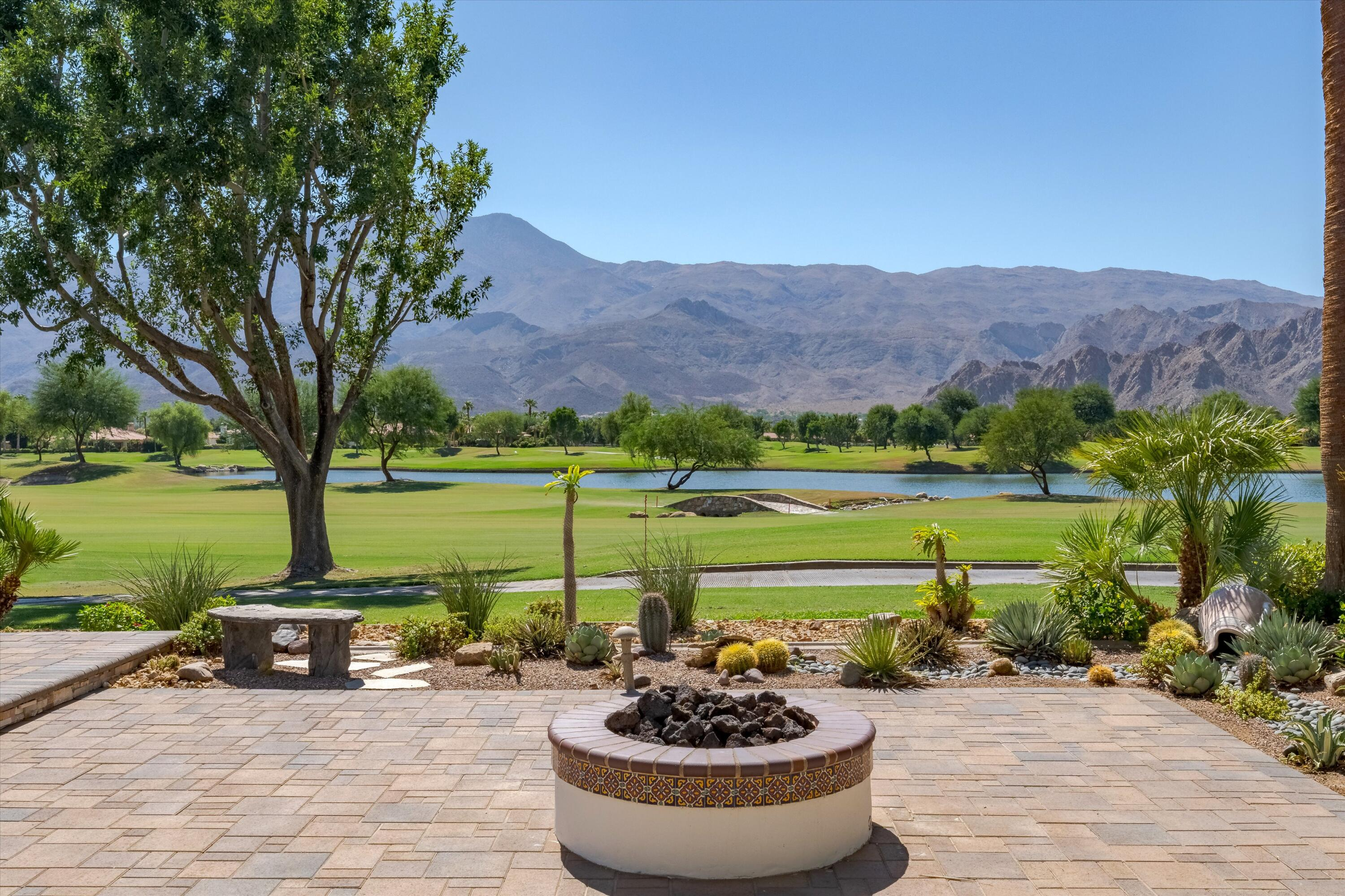 The Perfect 10! A magnificent southern view of the lake, mountains, and the 1st hole of the private Weiskopf Golf Course which is truly captivating. This luxurious freshly painted showcase home features 4,621 sq ft, 3bdrms, 4.5 ba, including a separate entry casita, plus media room w/ projector and a private office.  Exceptional interior amenities throughout including Fleetwood sliding glass doors, LED lighting, Travertine Flooring, built-ins, wine room, gourmet granite island kitchen, grand master bedroom suite, Enviroblind roll down sun/security shades, and more. Beautifully appointed with designer furnishings included. The resort-style backyard is breathtaking with covered patio room with BBQ and outdoor kitchen, fire pit, sculpture garden, large pool/spa, and cozy entry courtyard with fireplace, with pavers front-back, and side.  The garage features epoxy garage floors and an Electric vehicle charging plug (230V). You won't find a location to compare! Offered furnished per inventory.
