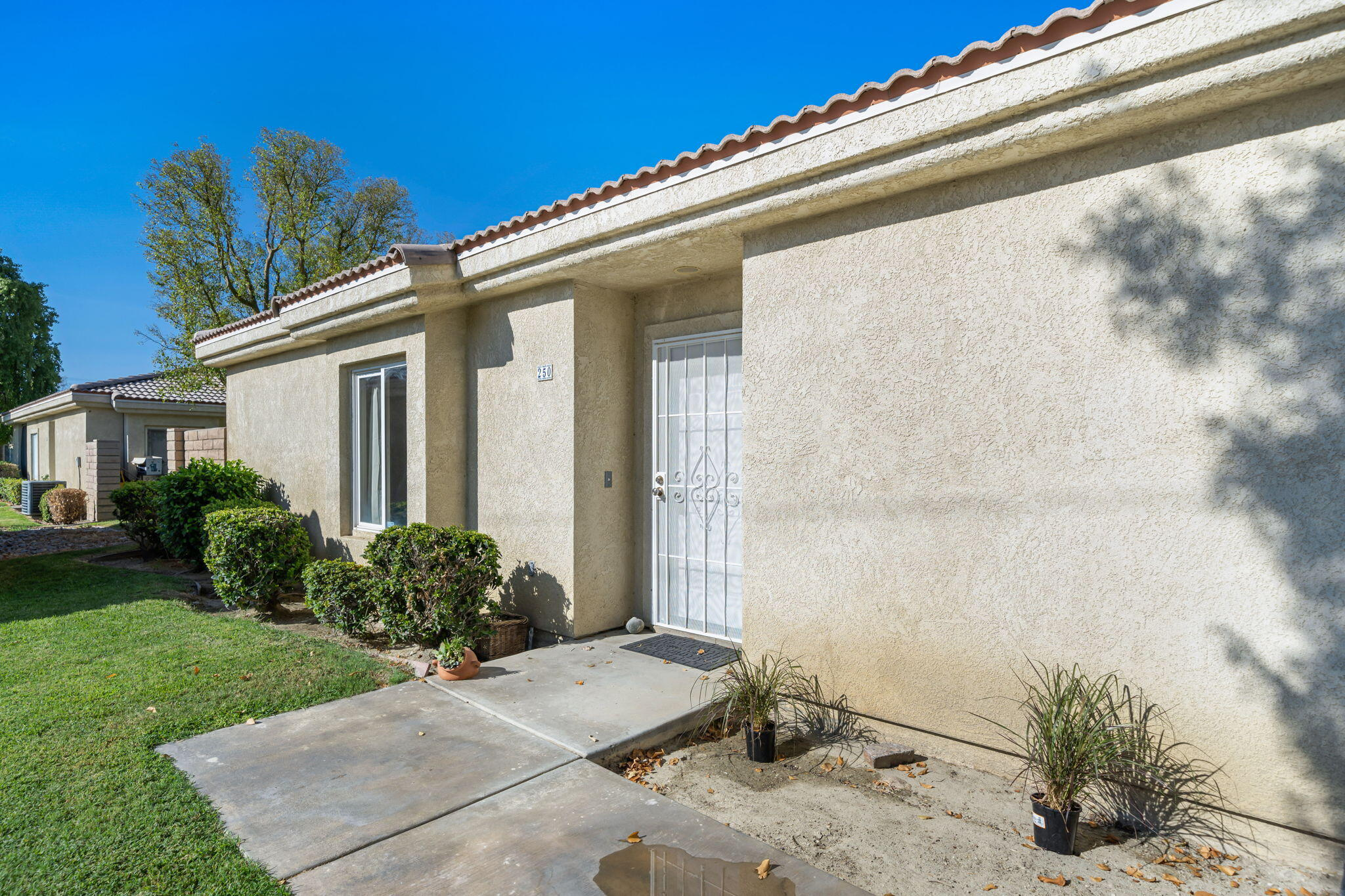 Recently updated, this bright and cozy open floor plan condo would make for the perfect home, investment, or Desert getaway. This home has been well- kept and boasts 2 bedrooms, 2baths, and a Den/Office space that is currently being used as a 3rd bedroom. Upgraded features include: granite kitchen countertops, new cabinets, new tile floor in the living room, kitchen, dining room, and bathrooms, remodeled primary bathroom, oversized barn doors and fresh paint throughout. Enjoy dinner or relax outside on your private patio located just off the primary bedroom. This condo includes its own one car detached garage. The HOA  includes water and trash and provides 3 pools, 3 tennis courts, a basketball court, and a Clubhouse. SummerBreeze is within close proximity to JFK Hospital, schools, shopping, golf, and Coachella and Stagecoach Music Festival Venue.