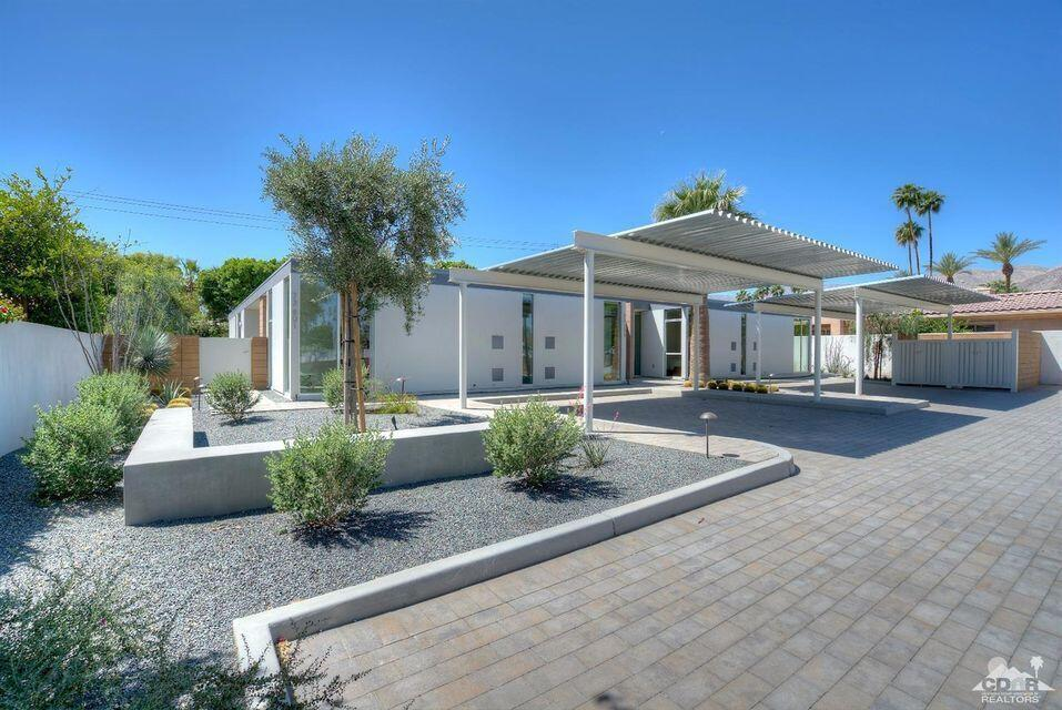 Sophisticated & Contemporary Architectural Condominium One Block From El Paseo In South Palm Desert. This stylish 2 bedroom and 2 bathroom condo has been designed with concrete floors and walls of glass. O2 Architecture & Developer Absolute Partners have incorporated modern design and state of the art energy efficiency in all elements of the construction. The open layout provides comfortable living.  This 4 unit enclave is conveniently located just one block from El Paseo and all of it's restaurants and shopping.  Low HOA of $250 per month does allow short term rentals.  Call me today to discuss this unique opportunity.