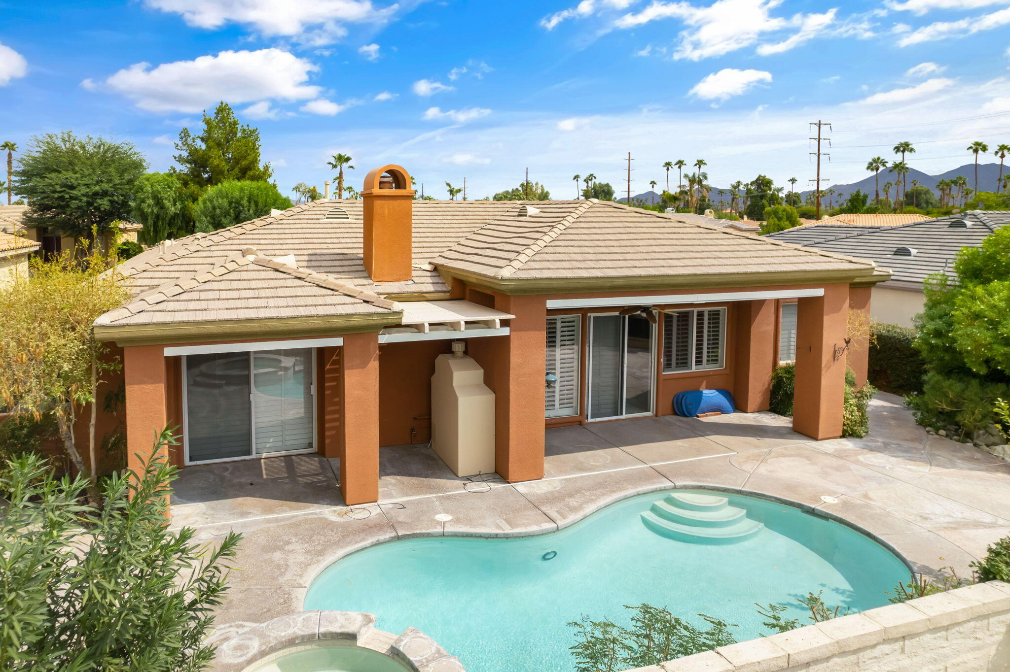 Treat yourself to easy-care living in this stunning Palm Desert home that captures sweeping views of the mountains. A grand glass entry welcomes you inside to discover high ceilings soaring overhead as tile flooring cascades underfoot, highlighted by recessed lighting throughout. Natural light fills the interior through multiple windows and glass doors adorned with plantation shutters. Show off your cooking skills in the bright, open kitchen featuring a double oven, a walk-in pantry, and a bar, plus the adjoining family room with a fireplace offers an ideal spot to gather. Discover stylish ceiling fans in the private retreats, along with custom-built cabinetry for ample storage. Explore everything your outdoor oasis has to offer, including a pool plus spa, three fireplaces, a covered patio with breathtaking views, a private courtyard, and a koi pond. Take advantage of additional noteworthy features such as Casita, attached 3-car garage with extra storage, a laundry room equipped with a washer/dryer, plus this inviting home comes wired for security. Ready to live the comfortable lifestyle you deserve? Come for a tour while you still can!