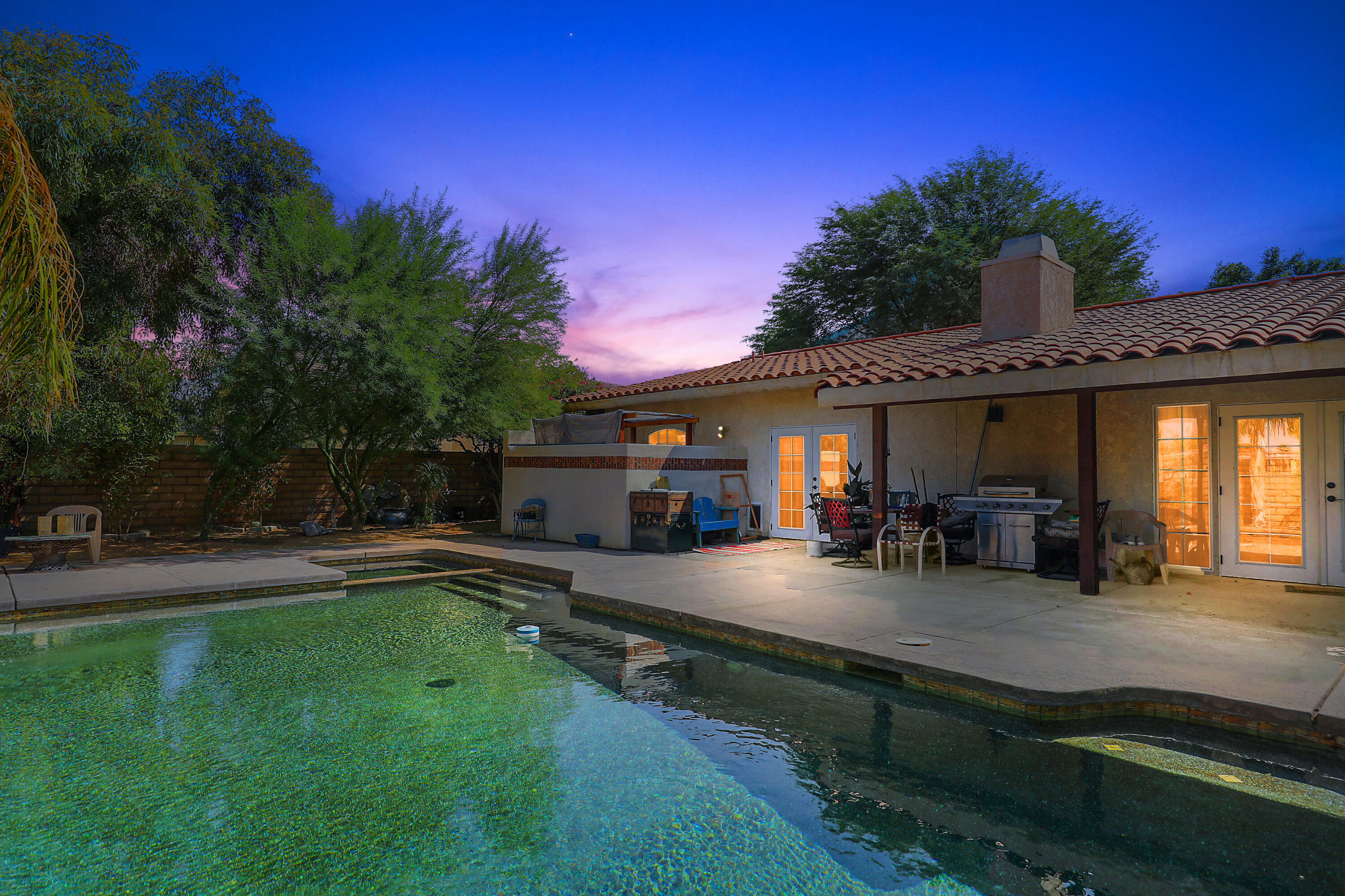 Thoughtfully remodeled Hacienda located inside the guarded gates of Bermuda Dunes Country Club. Enter through the wood-gated bell house (180 year old mission bell) into the expansive, private  front courtyard  area with fountain, mature landscape and covered tiled patio.   This charming home with 3 bedrooms, 2 bathrooms and over 1,700 sq.ft. of living space - you're sure to be swept away!!  Upgraded kitchen with stunning slab granite counters, custom cabinets and stainless steel appliances is open to a true GREAT ROOM with a cozy fireplace to give a warm glow to cooler winter evenings.   The primary bedroom has a slider to the rear patio and boasts a remodeled bathroom with separate tub and spacious walk-in shower.   The second bathroom with tiled shower has also been remodeled.     Step outside to relax and enjoy the refreshing Pebble-Tec pool and soothing spa.    The rear yard is expansive and has plenty of possibilities.   There is an automatic gate for the driveway and plenty of guest parking in front of this special home.    You will love living in this well maintained community with diverse homes and low HOA of only $199 a month, which includes 24-hour security and cable TV & internet with Spectrum (2 boxes with Showtime & HBO!!).   Owner will look at all offers on SATURDAY, October 2 at 4 PM.