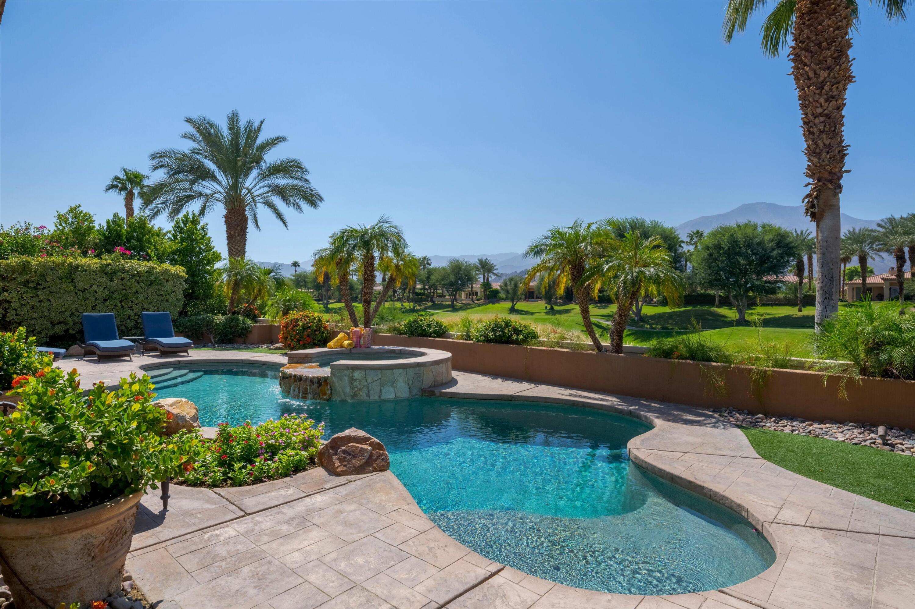 Spectacular Southwestern Mountain Views! Enjoy the American Express Golf Tournament from the amazing poolside patio! This gorgeous home at 2974 sq.ft, with 3BDs & 3.5BAs plus private pool & spa, offers gracious resort living at it's finest with an open-floor plan perfect for entertaining. Glass doors and windows provide sweeping panoramic mountain and golf course views! Beautifully landscaped gated courtyard with fireplace. Inside this stunning home is living room with fireplace, spacious master bedroom suite with sitting area, and large master bathroom with two walk-in closets, dining room area (currently being used as conversation area), wet-bar with granite countertops, ceiling mounted glass door-cabinets plus bar & wine refrigerators, stainless steel sink with garbage disposal and icemaker, media/den area, chef's kitchen complete with island, granite countertops, stainless steel appliances including 5 burner gas cooktop with downdraft range hood, warming drawer, double ovens, microwave, dishwasher, French door refrigerator and trash compactor, casual dining area offering some of the best seats in the house to enjoy that view, stone floors, ceiling fans, central vacuum system, much more. Marvelous backyard offers pebble tec pool and spa with cascading waterfall, putting green, electric patio awnings and built-in BBQ. Offered furnished per inventory.