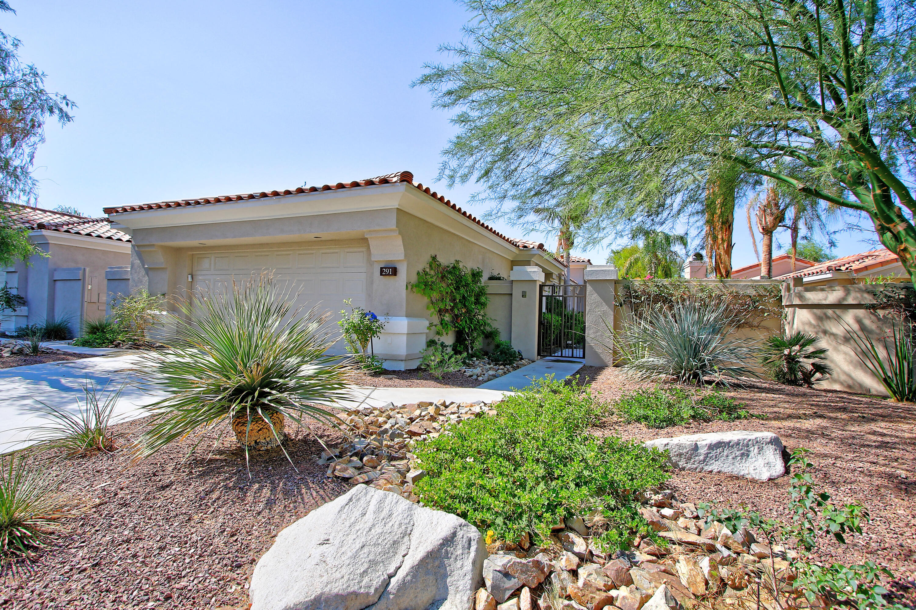 Don't Miss Out on this Southwest-facing Acacia 5 in Indian Ridge Country Club on the Grove #1 fairway with great mountain views.  This is the only home of this size and price for sale at this time in this sought after country club community.   2368 square feet, 3 BR, 3.5 Bath, with an open, inviting floor plan. The spacious kitchen is open to the family room, living room has built-ins, wet bar and a fireplace and open to the formal dining room with outdoor views.  The master bedroom has a patio door, full bath and a walk-in closet with built in cabinets.  The 2 guest bedrooms have their own bathrooms. Plus, there is a powder room. This property has No steps. The garage is a large 2 car garage with room for a golf cart. Club and Golf memberships are available.   Close proximity to Club house and all other facilities.  Furnished per Inventory list.  Whether you are looking for a vacation home or a home to live in year-round, this home is waiting for you to make it your perfect Desert Retreat!