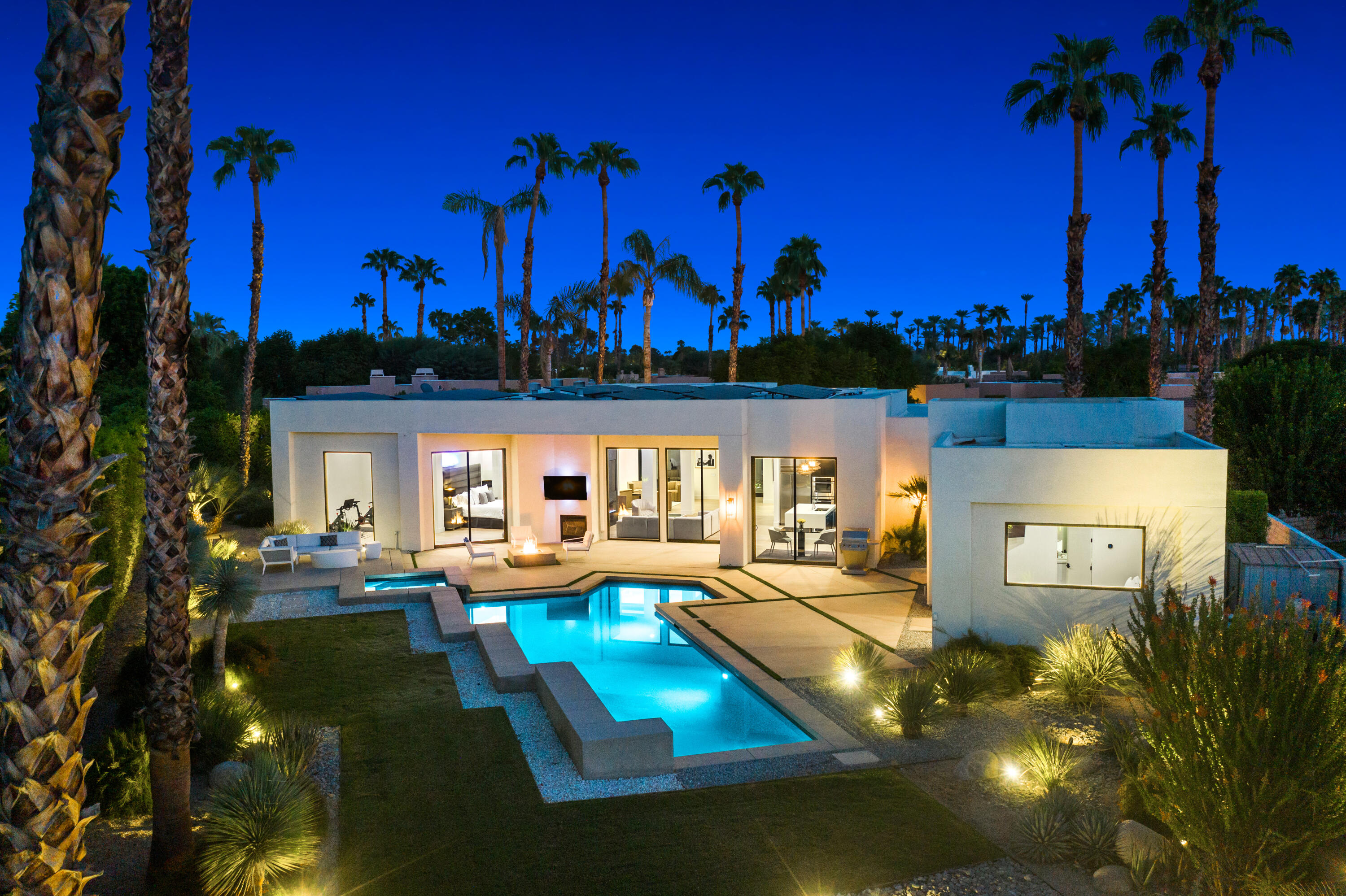 Located in the highly desirable Tamarisk area of Rancho Mirage sits Sterling Cove, a private gated community. Built on a large lot at the end of the cul-de-sac. This home has undergone an extensive renovation completed this year. Starting from outside of the property, with painting the exterior and adding custom contemporary gates. The property is on Solar, owned outright. New windows and sliders, along with a complete Whole-home 'Ecowater Systems' Softener + Reverse Osmosis, Owned outright. Enter the home through a dramatic, massive glass pivot entry door met with 'White Oak Engineered Hardwood flooring' throughout. This smart home has a 'Brilliant' control system and All features can be controlled from your smartphone as well. New 4 inch LED recessed lights, wall art-directional art lighting, recessed LED cove lighting in the entry and hallway. The living room has a seventy-five-inch linear electric fireplace with multiply color options that can be used with or without heat. Perfect for year-round use.  The primary bedroom offers LED Cove lighting, with direct access to the pool. Amazing mountain views right from your bed, also has a flex space that can provide a variety of uses.  The back yard feels like your own private resort with mature landscaping and a privacy hedge, pebble tech pool and spa.