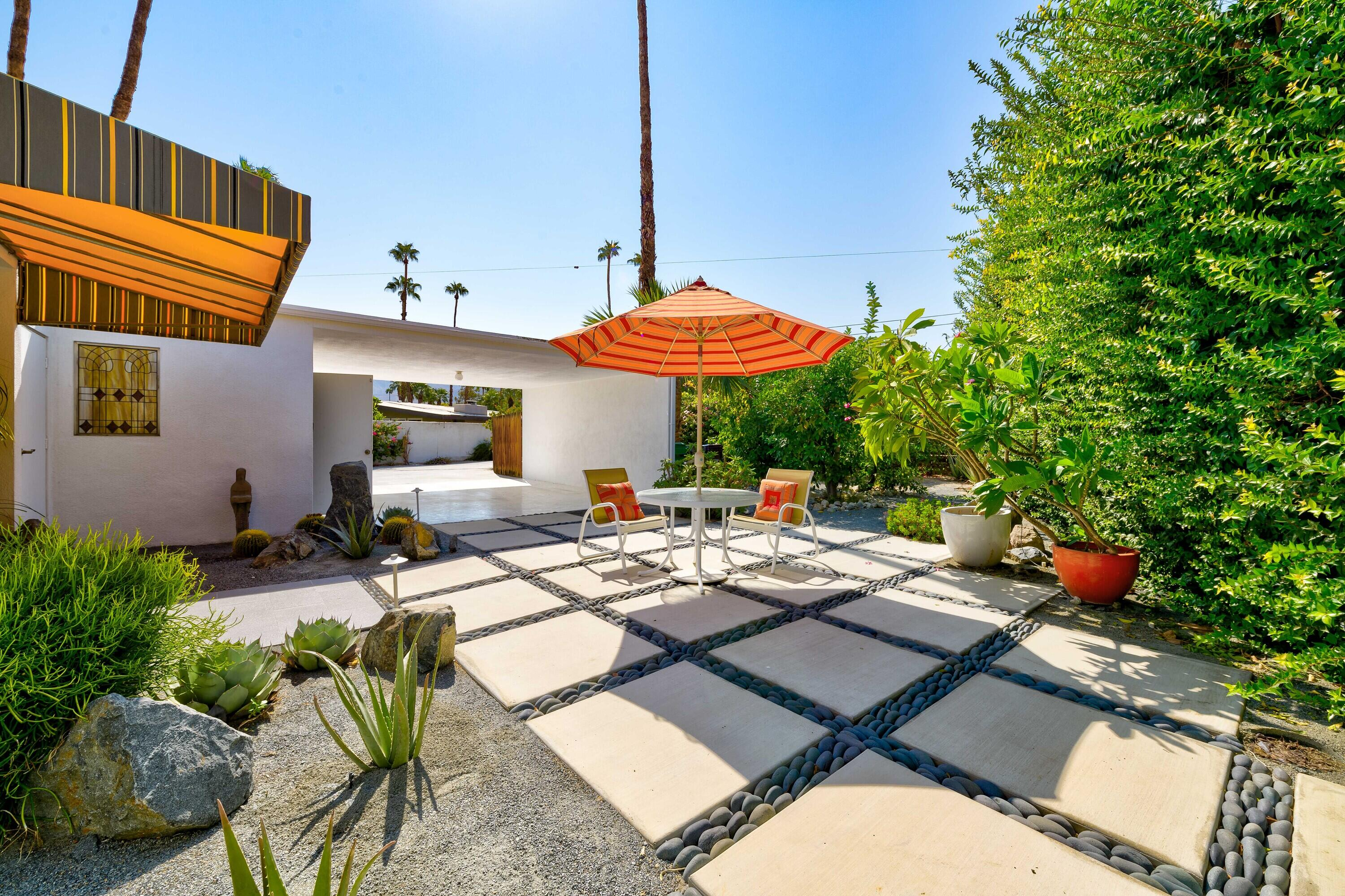 Simplicity of design is key to this mid-century modern home.  Floor-to-ceiling sliding glass doors with an emphasis to connect with nature and bring the outdoors in. Geometric cement and stone work in the front courtyard leads to a double door entry foyer with original Terrazzo floor. The open floor plan features a newly remodeled kitchen with sleek cabinetry, quartz countertops, customized tile and Newport Brass fixtures. The GE Cafe appliances are included. A Vintage Wet Bar is adjacent to the dining/living area. 2BR/2BA  The primary bedroom has access to a private side patio.  The secondary bedroom has an office alcove.. The bathrooms were remodeled with tiled showers, new fixtures, quartz countertops, and porcelain tile floors. There is an abundance of natural light throughout.  This is one of four mid-century homes sharing a history of Film and Broadway Stars from the 50's.  From the interior and the Lanai you'll enjoy the serenity of lush greenspace and mature landscaping..  A beautiful swimming pool beckons fun and relaxation for those within this private enclave. Desirable South Palm Desert neighborhood within minutes to the El Paseo Shopping District, Fabulous Restaurants, hiking, Theatres and so much more. This is a hidden Gem!  Move in Ready for full time or seasonal enjoyment.