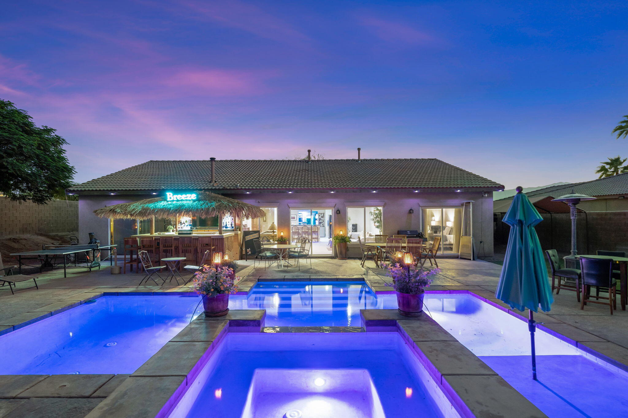 One of a Kind Pool Home on a Quiet Street inside Indio's Shadow Hills with Low HOA's, Casita, Gated RV Parking and the biggest and best lot in the area! The Breathtaking Backyard, 50% larger than others in the area, Compliments the 5 Bedrooms, 3 Baths, Casita home with Bonus Room and RV and/or Boat Parking.  This is Your Very Own Private Mini-Estate Retreat. There may not be a better home for entertaining in the entire Coachella Valley. No matter what type of toys, boats, bikes you may have, you'll have room for them here. The detail that has been put into the backyard amenities of this home are second to none! There is an enormous custom bar with television and neon signage which would be the focal point of any evening gathering, must be seen to appreciate! The Nighttime Ambiance of this well appointed Home would be the pride of any host. The Master Suite is located at opposite end of the Home from the other Bedrooms for privacy and the Casita is completely private with a dedicated entrance.  Don't miss out on this unique property for your most discerning buyers. There are  other pool homes with a casita in Indio but this type of backyard, Gated RV parking and almost half a fully developed acre inside a gated community is exceptionally rare. The entire backyard is landscaped, the grass is in and it is ready to be played on. Don't wait, come see this incredible unique resort mini estate today