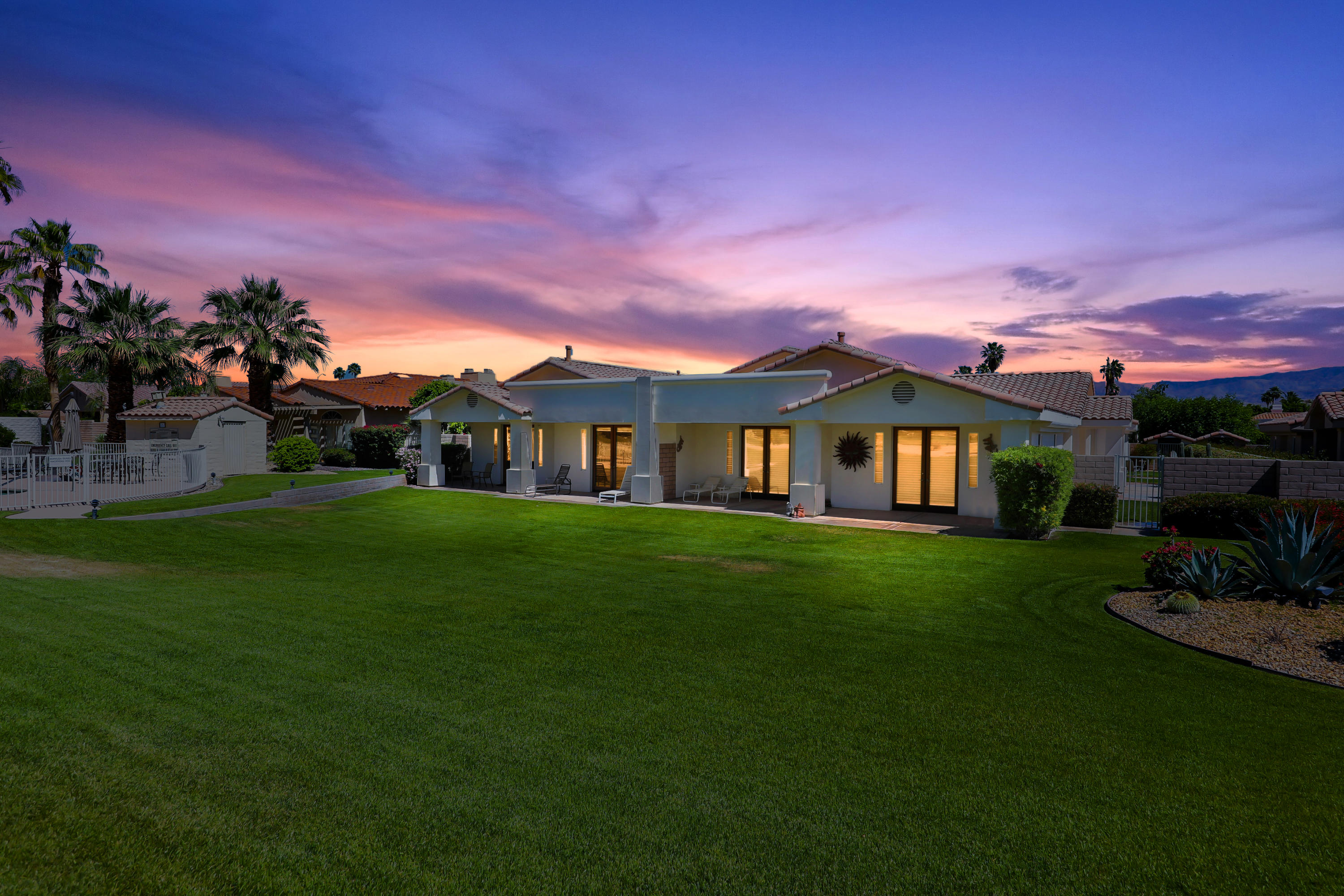 Welcome  to  La Haciendas, a 12 home development in Bermuda Dunes C.C.  This sought after paired home is one of eight attached homes built by Doug Wahl and is one of  the first steel framed homes in BDCC. Spacious floor plan with 3 bedrooms (including an attached Casita with separate entrance),  3.5  bathrooms,  PLUS an office (currently used as a fourth bedroom).  Home is on the 2nd fairway of the Classic Course and has  SOUTHERN MOUNTAIN  views from the rear patio. This unique property also has a private side yard for intimate outside dining or is great if you have a pet.  True great room plan wherein the gourmet kitchen with slab granite counters and stunning cherry cabinets is open to the dining room and family room.   The spacious formal living room with fireplace and door to rear patio is great for entertaining or watching your favorite video on the large screen TV.   The primary suite also has a door to rear patio to take in the Southern views and a fireplace for those cooler evenings  plus a sumptuous bath with marble shower, granite counters and spa tub with marble surround.   Guest suite with 3/4 bath, and office with French doors (currently used as  a bedroom).  Attached CASITA with separate entrance, frig, 3/4 bath and sitting area.  Two-car attached garage plus separate golf cart garage.   HOA of $199 includes cable TV w/two boxes with Showtime & HBO, plus internet with Spectrum.   HOA of $525 incl. pool & ground maintenance.  Connected to SEWER!