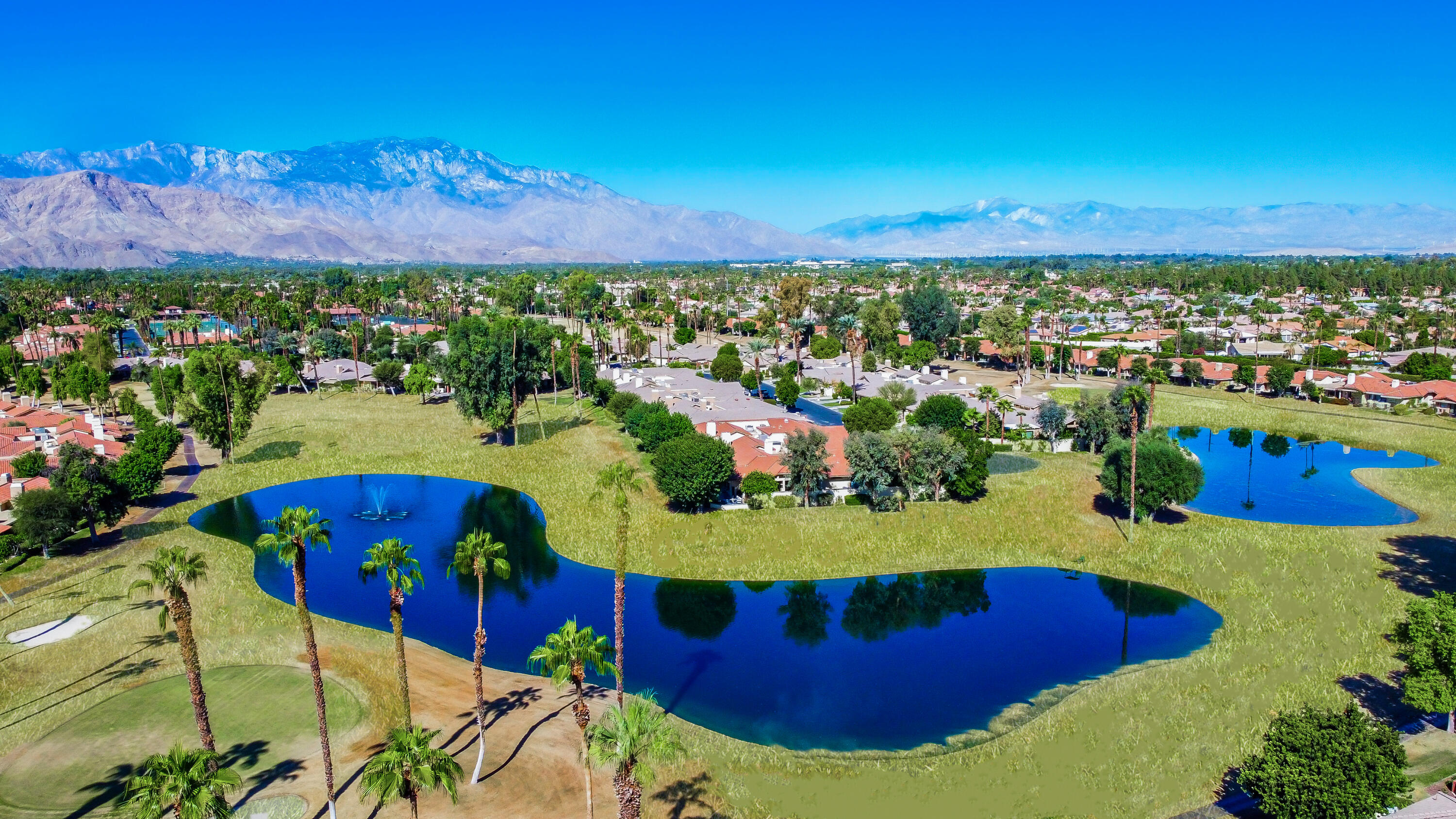 RARELY does a home become available on this private street of only 4 units. This is the most sought after location in Monterey Country Club. Eye popping views showcase the San Jacinto mountains, wide open views of golf course and two lakes with fountains. Walk into the private rose filled courtyard and enter into a beautiful 3/2 home completely remodeled with smooth ceilings and walls, custom lighting, remodeled bathrooms and kitchen. The kitchen boosts superior Italian stainless steel appliances by Bertazzoni and consist of gas range, refrigerator with french doors, ventilation over range is also Bertazzoni the dishwasher is Bosch. Custom white cabinets have been ordered and will be in place by the end of Oct. Meanwhile open shelving and custom cabinets have easy pull outs.  Home explodes with natural light and atrium has been left to bring in extra light and air especially the second bedroom which also makes a wonderful retreat. Brand new HVAC unit has been  installed also Smart/Nest thermostat. Pool? You won't believe the pool just steps away at the end of the street so private that no ones knows it is there. You have to experience this home to enjoy the love and dedication that went into making it so special. The extended patio with electronic awnings is just one of the things that gives you a very special feeling of contentment. When you sit out on the patio with your morning coffee or your favorite evening  beverage, I just know what you will say, Awwwww, Life is Good!