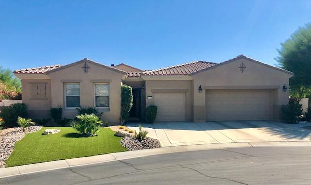 This upgraded La Paz  model is located on a cul de sac just a short walk to clubhouse. A separate detached Casita off a covered entry with security gate leads to beveled glass front door. Open floor Plan with fireplace, Separate Formal Dining room, Gourmet Kitchen with large granite slab Island overlooking covered patio and pool.