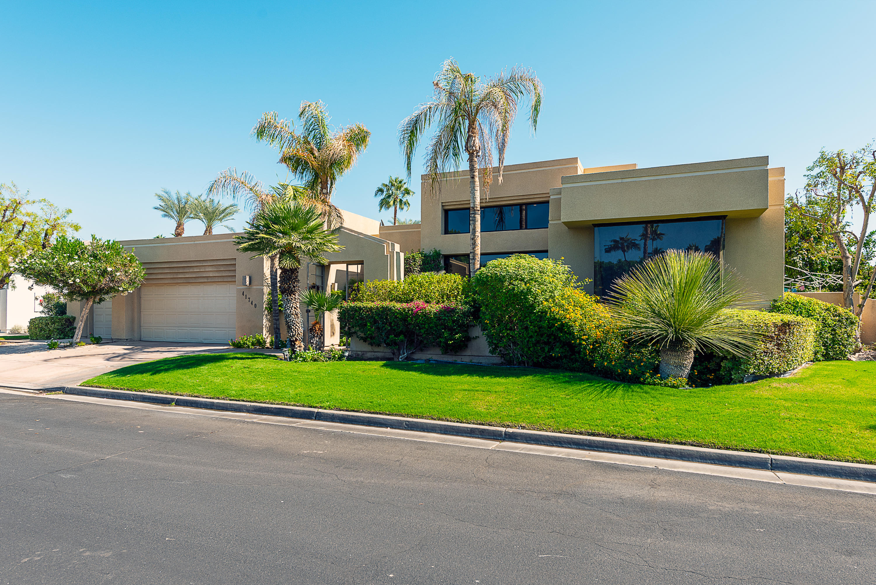 This refurbished Sunterrace home has a wonderful floor plan and is the largest plan in this quality build complex. The grand double door entry into a massive foyer with lighted art nooks set the tone of elegance. Glide into the Living Room and enjoy the 16 ft ceilings and marble fireplace with raised hearth, move to the elegant formal dining room with built in Buffet and serviced by a gourmet kitchen with high end cabinets and appliances. Enjoy the large great room with step down wet bar and 2 separate counters for informal eating and socializing. Also featured are 2 very large Master Suites, both with large walk in closets. The main master has sunken tub with jets & marble counters. All Baths have new glass for the showers. There is a Den or office that  can also be the 4th bedroom when needed. The Private backyard features a large cover patio area for relaxing, has lush landscaping and a newly surfaced  Pebble Tech sparkling pool with water fountain and spa. The peaceful landscaped yard create a lush and tranquil setting in the outdoor spaces.  You will love the free-standing  casita with a built in barbecue & wet bar. This is a great home for entertaining. This is a wonderful controlled gated neighborhood, close to the 10 freeway , nearby shopping on El Paseo, hospitals and all the wonderful restaurants in Palm Desert  and the Golf and Tennis tournaments of Indian Wells and La Quinta. What more could you ask for! Call for appointment for your private showing today.