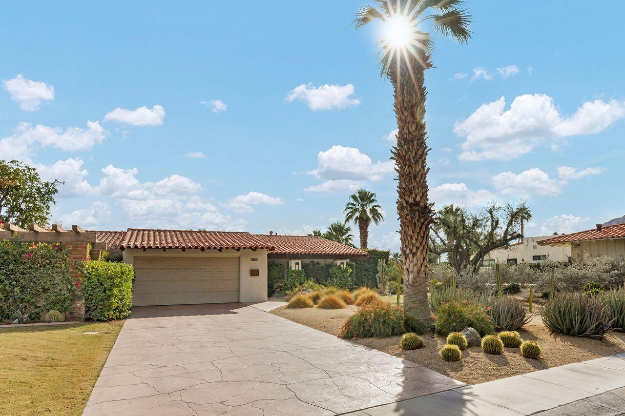 This stunning and elegant, 3 bedroom, 3 bath Villa, is a rare find, situated above the valley floor, with gorgeous mountain views all around, in the very desirable Thunderbird Villas. Walking up to the property, you'll appreciate the custom driveway, and recently repainted exterior. Entering the private front courtyard reveals a beautifully updated and well cared for home, with tasteful tile flooring throughout. The kitchen features slab granite counters, a breakfast bar, updated fixtures, newer stainless-steel appliances, and under countertop mounted stainless-steel sink. The kitchen opens to the living room with dramatic open beam, vaulted wood ceilings, and an adobe style fireplace. The dining area features double sliding glass doors and plantation shutters leading to the rear patio. The rear patio offers gorgeous mountain views, and wraps around to reveal an outdoor dining area, and a doorway leading to a secluded private patio/living space. All three bedrooms feature stunning open beam ceilings. Plantation shutters at the 2nd bedroom reveals sliding doors leading to the rear patio. Slab granite counters adorn all three bathrooms. Sliding doors from the master bathroom leads to a beautiful private patio. There's a 2-car attached garage, and lush, mature landscaping. A community pool is steps away! HOA includes community guard gated entry, cable, trash, landscaping and community pools. Some furnishings and golf cart are available/negotiable, outside of escrow.