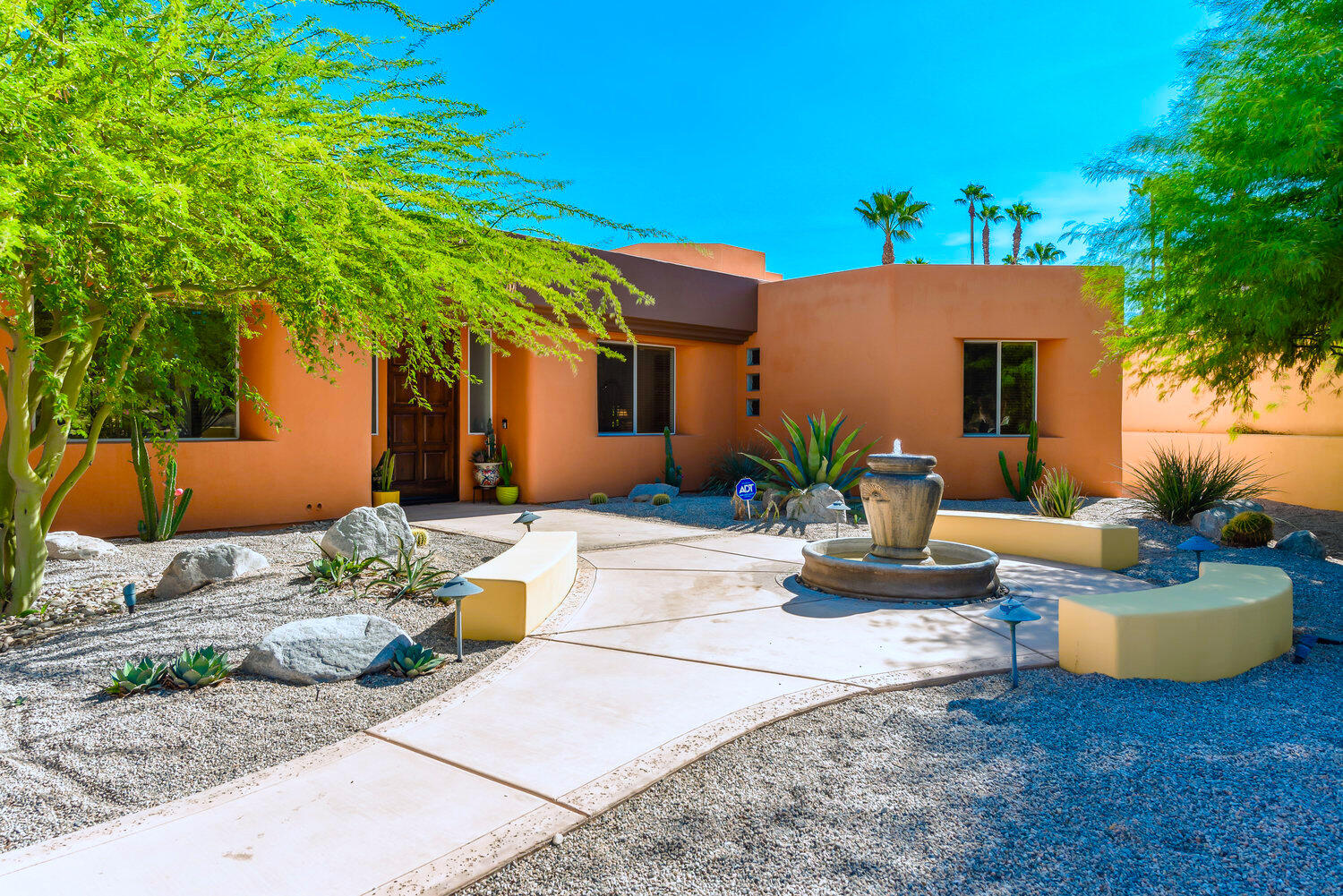 Crisp, clean, beautifully updated home with low $18/month HOA, on a non-gated street of desirable South Palm Desert.  Close to El Paseo, the Living Desert (Zoo), hiking trails, a highly sought-after charter school, and high-end communities.  Property features 12-foot ceilings, open floor plan, designated dining area, great room and living room separated by a dual sided fireplace.  Large Master suite with expansive views of the yard and mountains, large walk-in closet, walk-in shower and dual sinks with plenty of storage.  The yard is an entertainment heaven.  Well appointed with fire pit, multiple fans, built-in sound system, two electric awnings expanding the entire south-east side of the property, and large salt-water pool with elevated spa.  Entire property is desert landscape for low maintenance. Mountain views from almost every room in the house. Come see this property in person at one of our many open houses. This desirable property will go quickly, don't miss out!