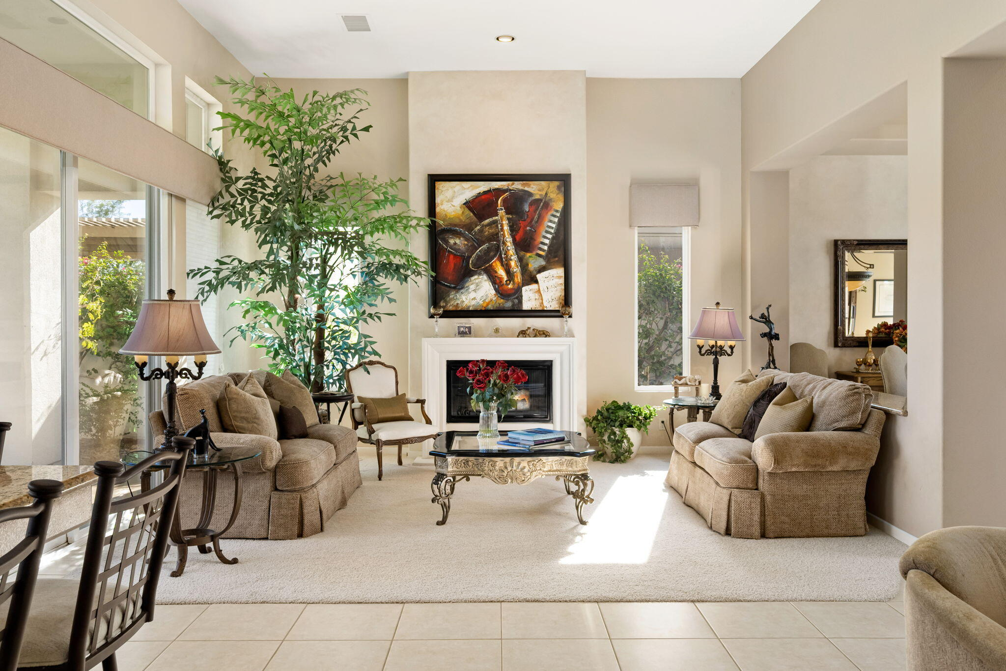Beautiful Indian Ridge Country Club Single Family Golf Course Home. Popular Open Floor Plan with 3 Bedrooms and 3.5 Bathrooms. Formal Living Room with Fireplace, Formal Dining Room & Family Room with Bar and Built-in Cabinetry including 70'' TV. Gourmet Kitchen with stainless steel appliances, pantry & granite counters. Large Master Bedroom Suite with two closets Bath with dual sinks, vanity, separate Shower & Spa Tub. All bedrooms are ensuite, plus a lovely powder room for guests. Two new A/C units were installed last year, plus another A/C in the 3rd Bedroom/Office. The exterior of the home has recently been painted. This lovely home is centrally located in the PUD section of the club on a elevated lot, on a Quiet interior street & close to several community pools and spas. The patio has a built-in BBQ & Beautiful Fairway & Chocolate Mountain Views. Fabulous resort style country club features two 18 hole Arnold Palmer Golf Courses, 14 Tennis and Pickle Ball Courts, Lap Pool, Dog Park, 30 community pools& spas & 3 great Restaurants. The state-of-the-art Fitness Center includes daily classes, steam room & sauna. The full-service Day Spa offers Massage, Facial & Hair & Nail Salon services. Club members enjoy an extensive Social Calendar with numerous activities & events that include something for everyone. HOA dues include Cable TV, Trash collection, maintenance of common area landscaping and 24 hour security guard service. Membership available.
