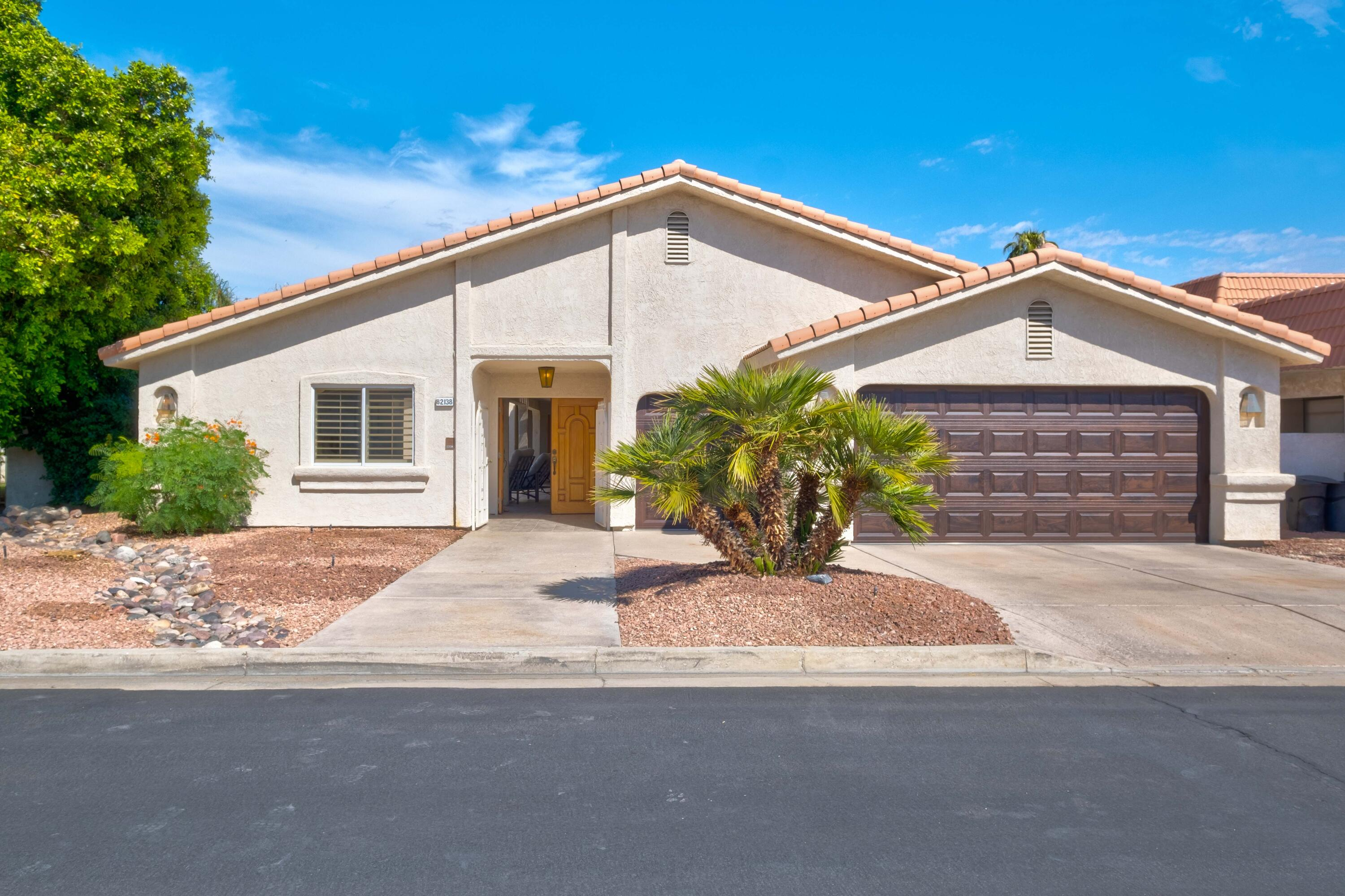 This beautiful legacy home is a large 3 bed / 3 bath, which includes a 1 bed / 1 bath detached casita and features a private courtyard with private pool and spa.   Double door courtyard access brings you to the formal entry, where you'll find two big living areas with large windows that frame the golf course and mountain views.  This immaculate home has a large mirrored formal dining room that is great for entertaining, a tiled kitchen with views from the kitchen sink and a built in office! The master suite features a big walk in closet / dressing room with a chandelier and glass slider access to the courtyard and pool.  You'll find plenty of storage space in the oversized laundry / utility room.  This home has been updated with new tile and carpet flooring and two brand new garage doors.  You'll find plenty of space in the two car garage with a separate golf cart garage.  The detached casita is spacious with 2 entries!  This is a unique opportunity for a second/vacation home.  30-day minimum rentals and you can't beat the LOW HOA's!  The Indian Palms community features community pools, fitness center, restaurant, public golf course and pro shop and guarded gate access.