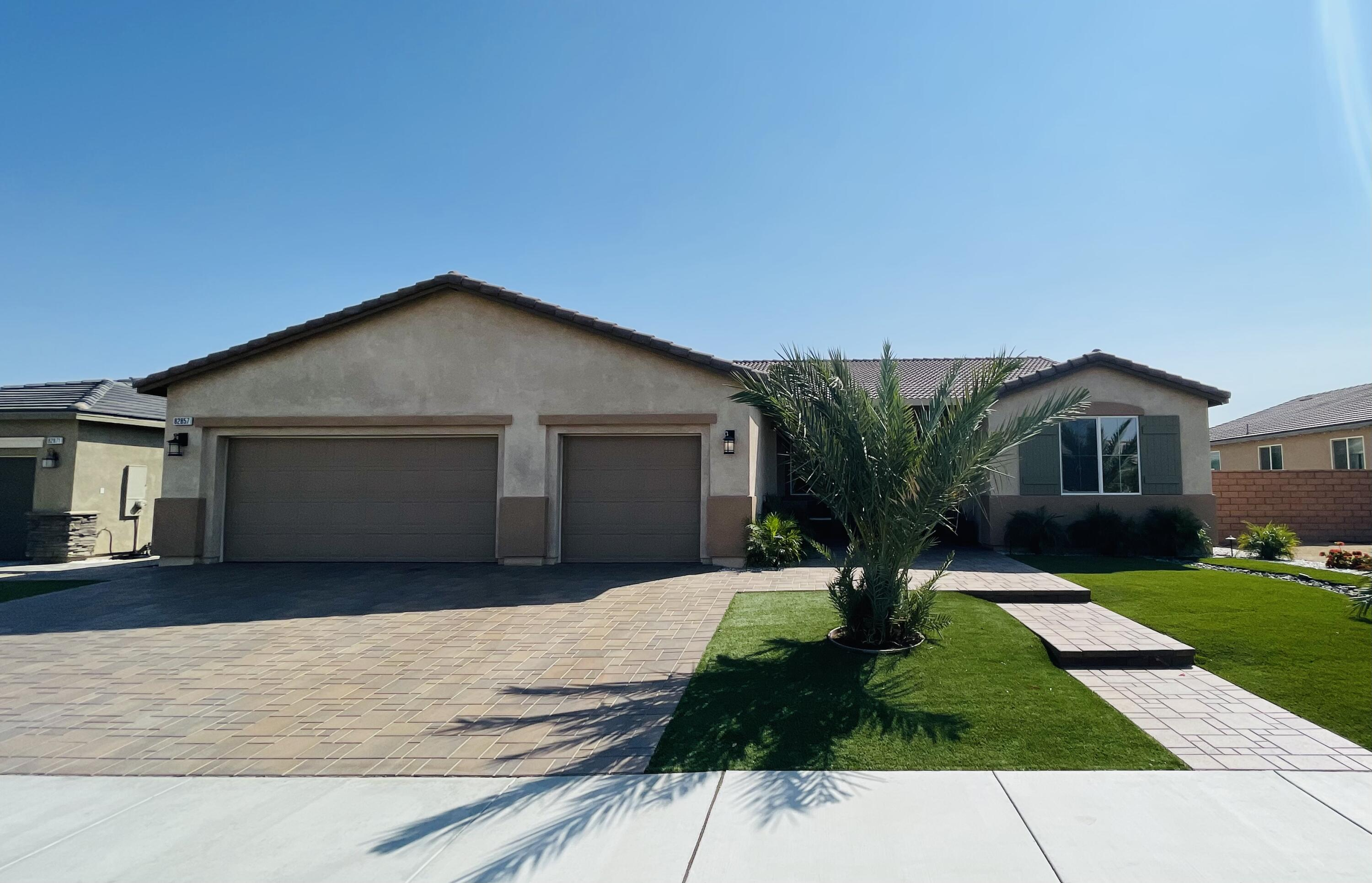 The prestigious community Whitter Ranch presents an eye-catching property, awaiting a lucky new owner. Newly constructed Airbnb's favorite, get ready to own your dream home! Over $180,000 dollars in upgrades! This 4 bedroom and 3 bath home with pool/spa. Designed for indoor/outdoor living, this newer home offers an expansive floor plan and oversized lot. A grand courtyard entrance welcomes you into the home. From the moment you walk into the home you will be impressed by the large open concept design with a connected living room, kitchen and home office that is perfect for gatherings. Custom dark mahogany cabinets with oversize white island in the kitchen area. Its striking single-story floor plan boasts everything from grand living areas and oversized bedrooms. This home is perfect for luxurious living and entertaining guests.  There is an oversize covered backyard patio with upgraded led lights, ceiling fans and misters, There is also a large 10ft long BBQ island, a 40in stainless steel natural gas grill. Amazing natural gas stone firepit.  Fully automated heated POOL and SPA with color led ambient lighting. Ample parking space with upgraded custom pavers, an oversized 3-car attached garage parking are a few bonus features that you will enjoy. This professionally designed property of extraordinary luxury and beauty is waiting for you, No HOA walking distance for festivals venues and shopping center, centrally located. Must SEE!! Welcome to Paradise!