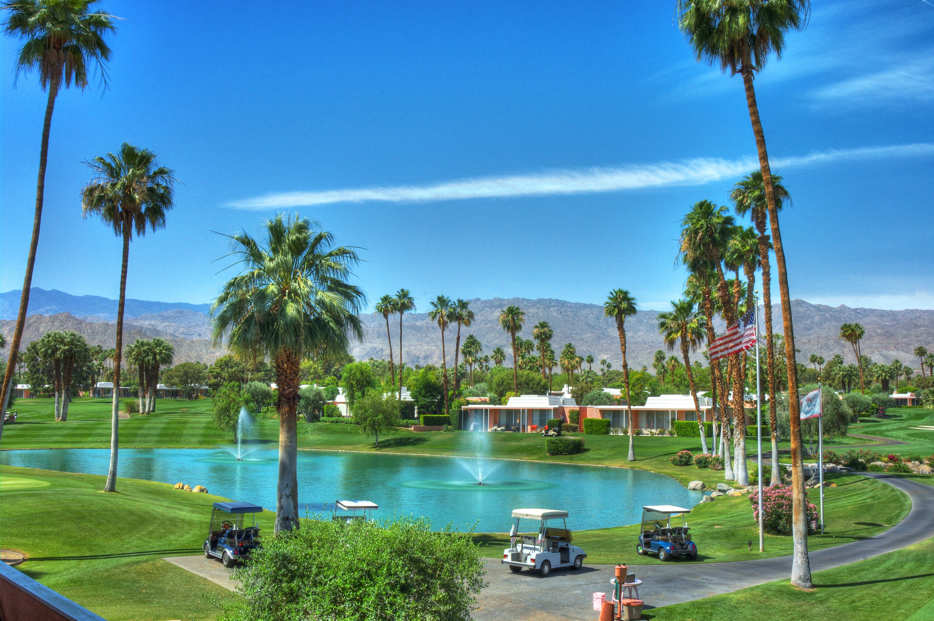 Marrakesh Country Club is an exquisite John Elgin Woolf architecturally inspired luxury community in the heart of Palm Desert just blocks from the upscale shopping and dining street of El Paseo.  This unique residence welcomes you through an oversized front courtyard with pet friendly lawn, wood burning fire pit, outdoor shower in the atrium and a lush desert landscape.  The oversized double door entry opens to a large living room/dining room with wall mounted surround sound TV, modern electric fireplace, and dramatic chandelier.  The kitchen boasts new appliances with adjoining laundry room and pantry.  Walls of glass open to a rear- patio steps to NEW 18 hole putting green and NEW state of the art Clubhouse to be completed Spring of 2022.  Enjoy amazing golf course and sprawling mountain views in this comfortable desert home.