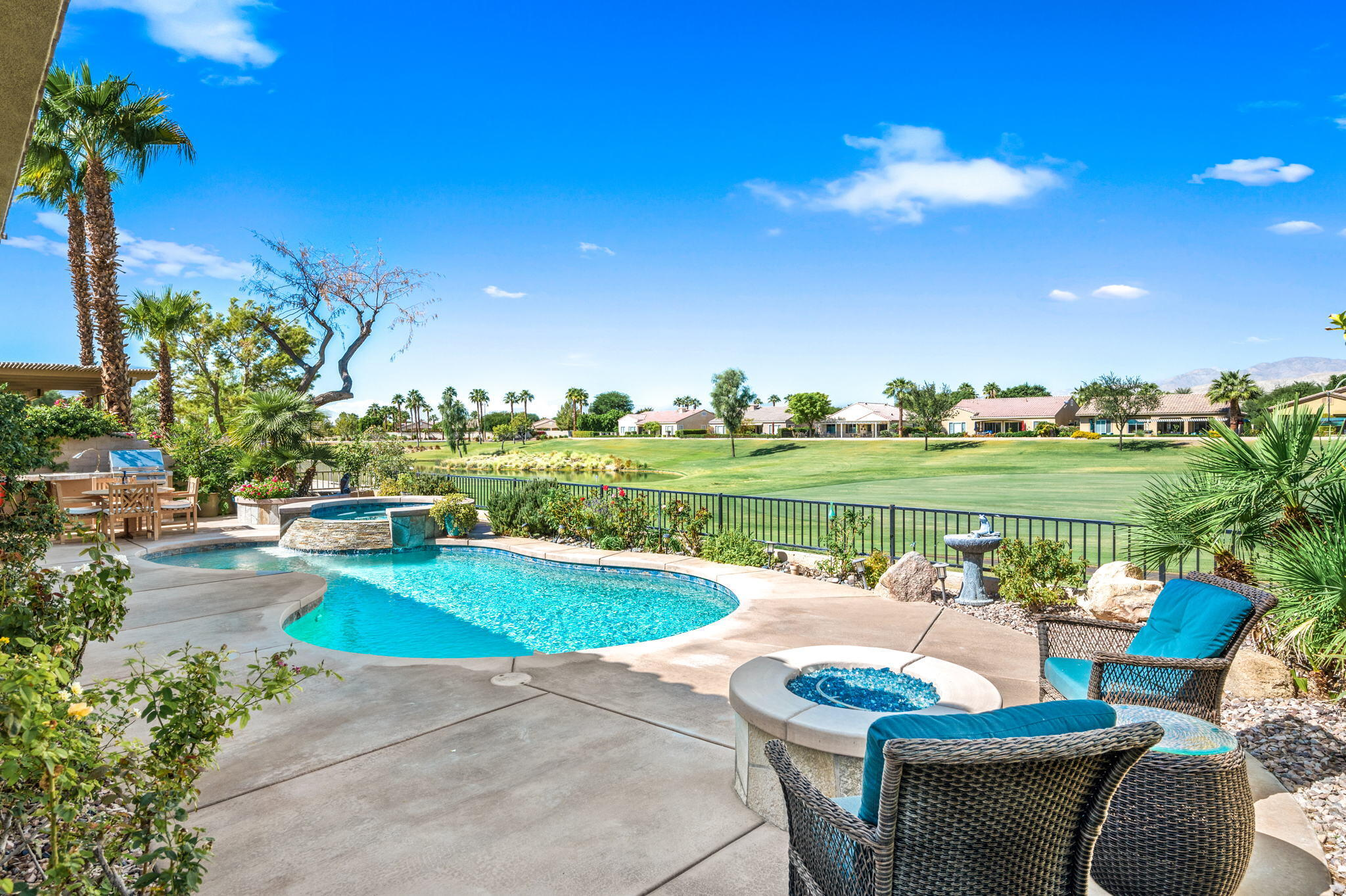 Enjoy... Panoramic Golf, Water & Mountain-Sunset Views! This favored Sorrano model offers 3 Bedrooms, 3 baths, Den/Office!  You'll be greeted with a Charming yet Private Courtyard entry.  Casita is Newer (home was formerly Madera) with an added Casita... built in Murphy Bed, easy care Laminate flooring, Granite Vanity, upgraded Mirror &  Beautiful Tile Shower! Separate AC/Heating for Casita!  Open & Inviting Great Room, Den/Office, Updated Porcelain flooring throughout main home, New Carpet in Bedrooms and Den.  You'll Love this Kitchen... w/ Granite Island, Stainless Steel Appliances, plenty of cabinet space, pantry and breakfast nook! Fridge Included. King Sized Master Bedroom with a view! Master Bath w/ separate tub & shower, dual sink vanity, walk in closet.  Guest Bedroom is Queen Sized with bath adjacent.  Slider door from Dining area to covered patio with Ceiling Fan &  Stainless Steel Industrial Misters!  Beautiful Pool, Spa, BBQ Island, Fire Pit... this home checks off all the boxes!  Individual Laundry Room w/Deep Sink & plenty of Cabinets for Extra Storage! Two Car Garage with 220 to accommodate your EV!  This home is located Centrally within the community to afford you easy access to both clubhouses, Shadows Restaurant, Golf!  The North facing leisure allows you to Enjoy your view all the time... no need to block out the Sun and your lovely view! Welcome Home