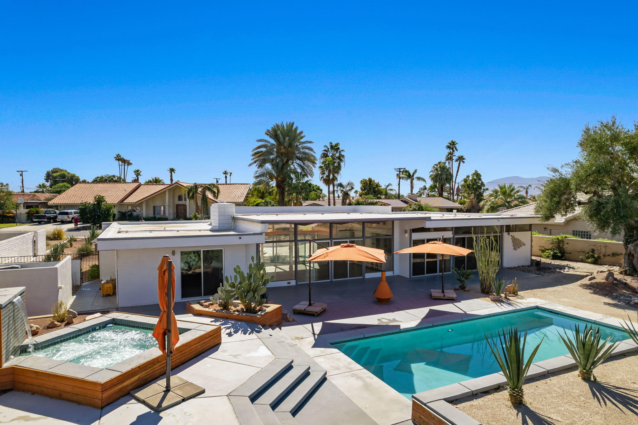 Your chance to own an iconic, Mid-Century pool home on a stunning golf course with explosive mountain views! Situated behind the gates of Bermuda Dunes Country Club and rich with hosting the infamous Bob Hope Classics for 49 years, this entertainer's home features a semi circular driveway, impressive double door entrance with clerestory windows in every room that perfectly feature the our desert mountain tops, the multi level pool area and prized golf course. A rare three bedroom, all ensuite and two feature walk-in closets. Additionally all bedrooms have sliders leading to the pool area and huge outdoor living spaces with too many features to list.  BDCC HOA is $199 per month and includes guarded gates of entry, 24 hour security patrol, cable package with premium channels including Showtime & HBO, wifi/internet and all equipment to operate - all included in the HOA fee! In this part of the valley electricity is provided by IID which is significantly less expensive than SCE. Recent improvements include:  added foam roof, new HVAC, Quartz kitchen countertops, remodeled 3 bathrooms, replaced 9 sliding doors, replaced carpeting in bedrooms, repainted indoors and outdoors, new pool heater, filter and pump, acid washed pool, new garage door and lift motor, new double front doors, new main electrical feed, new hot water heater, upgraded exterior lighting, upgraded stovetop to gas, added access to septic tank, rewired pole to house, repainted fence and perimeter walls.